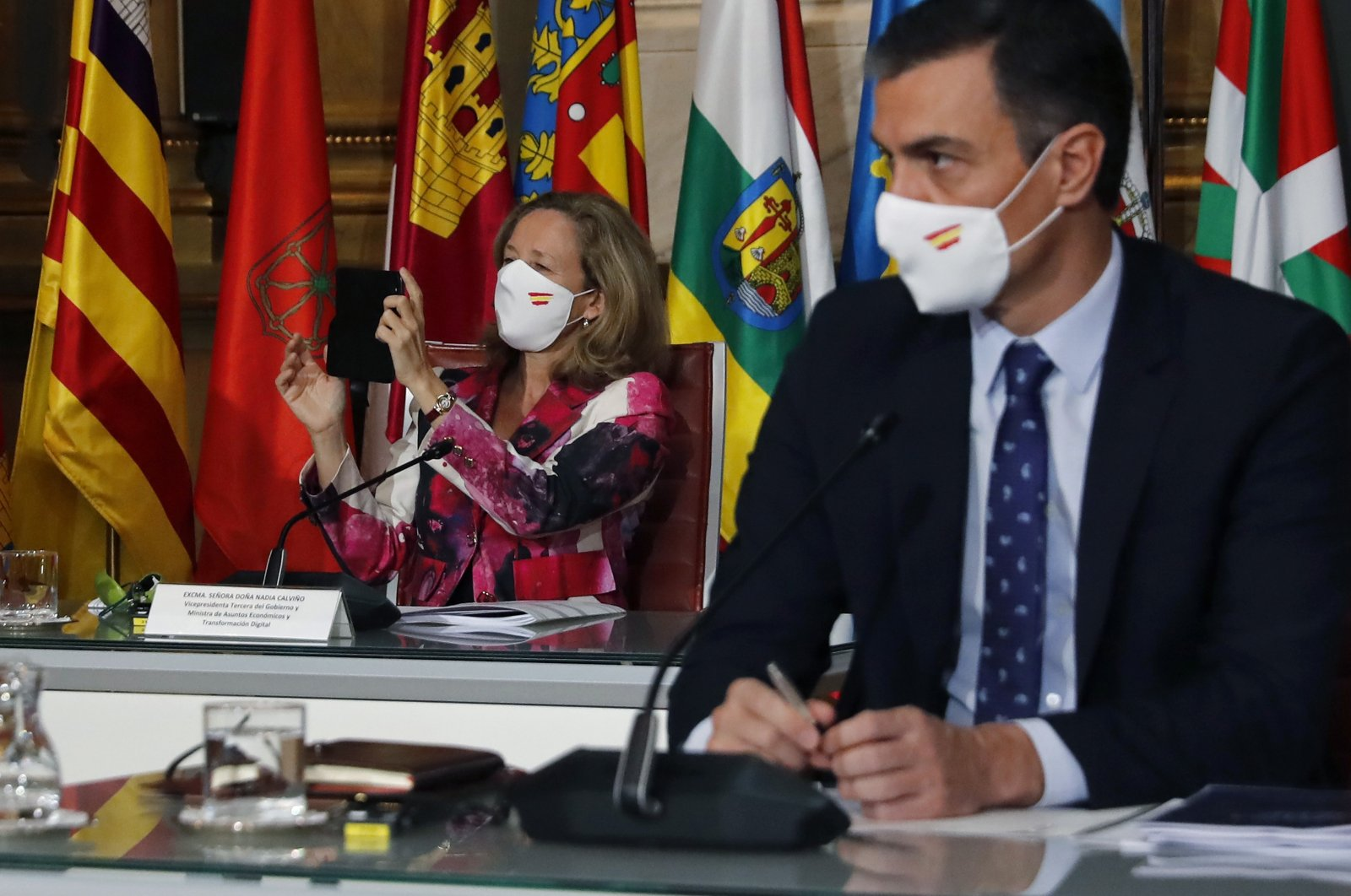 Spanish Economy Minister Nadia Calvino (L) and Prime Minister Pedro Sanchez attend the Regional Presidents Conference in Madrid, Spain, Oct. 26, 2020. (EPA Photo)