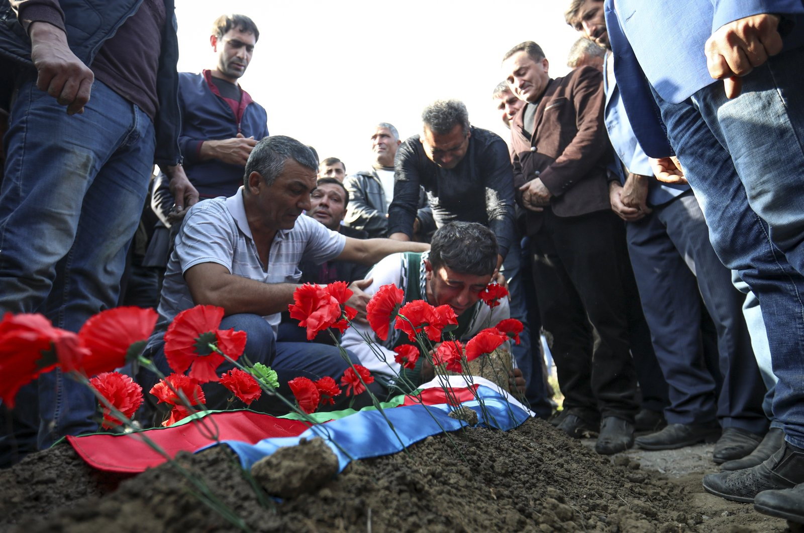 The father of 7-year-old Aysu Isgandarova, who died during shelling conducted by Armenian forces, mourns during a funeral in Garayusifli, Azerbaijan, Oct. 28, 2020. (AP Photo)