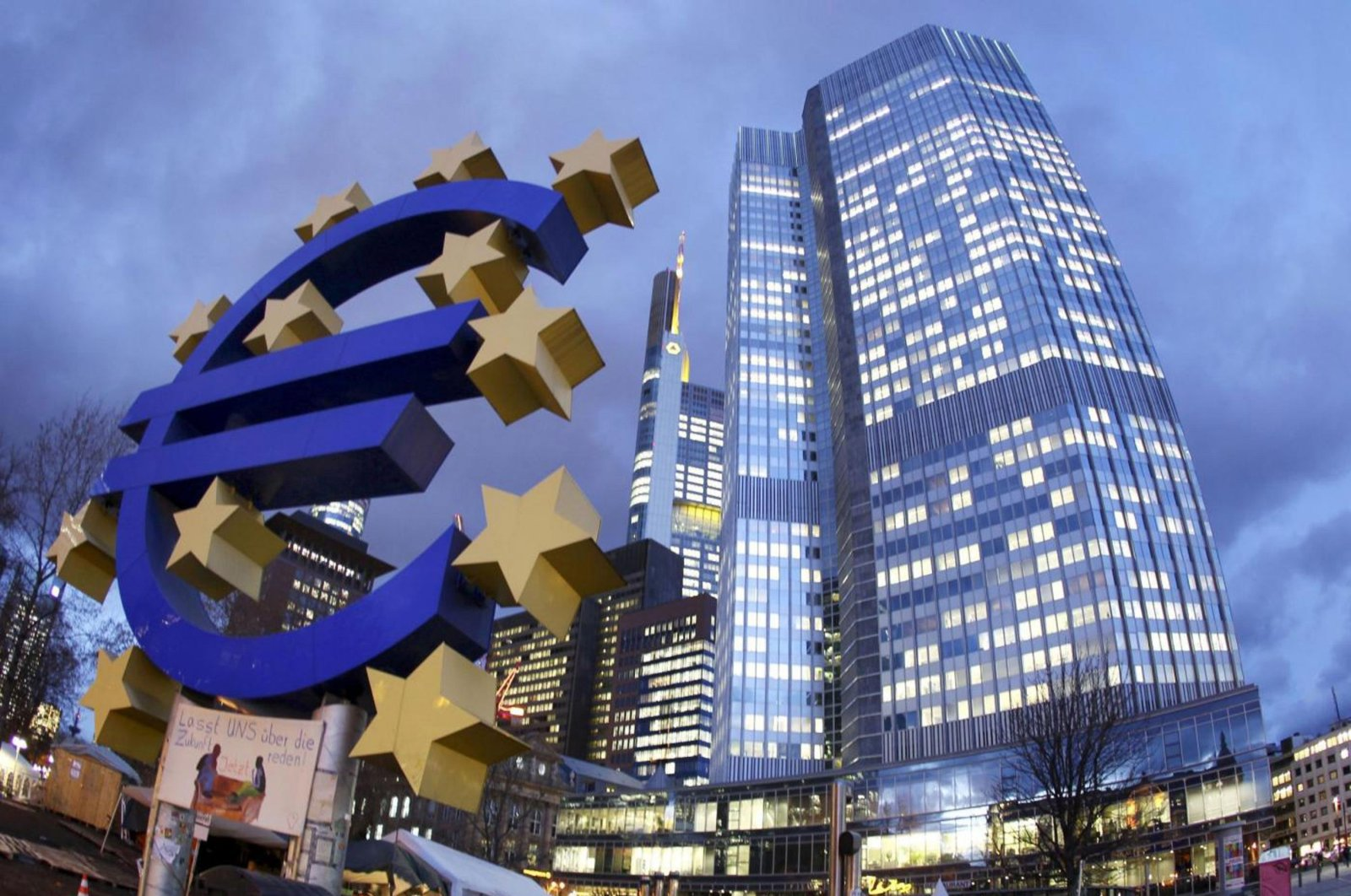 The Euro sculpture stands in front of the European Central Bank, right,  in Frankfurt, Germany, Dec. 16, 2011. ( AP File Photo)