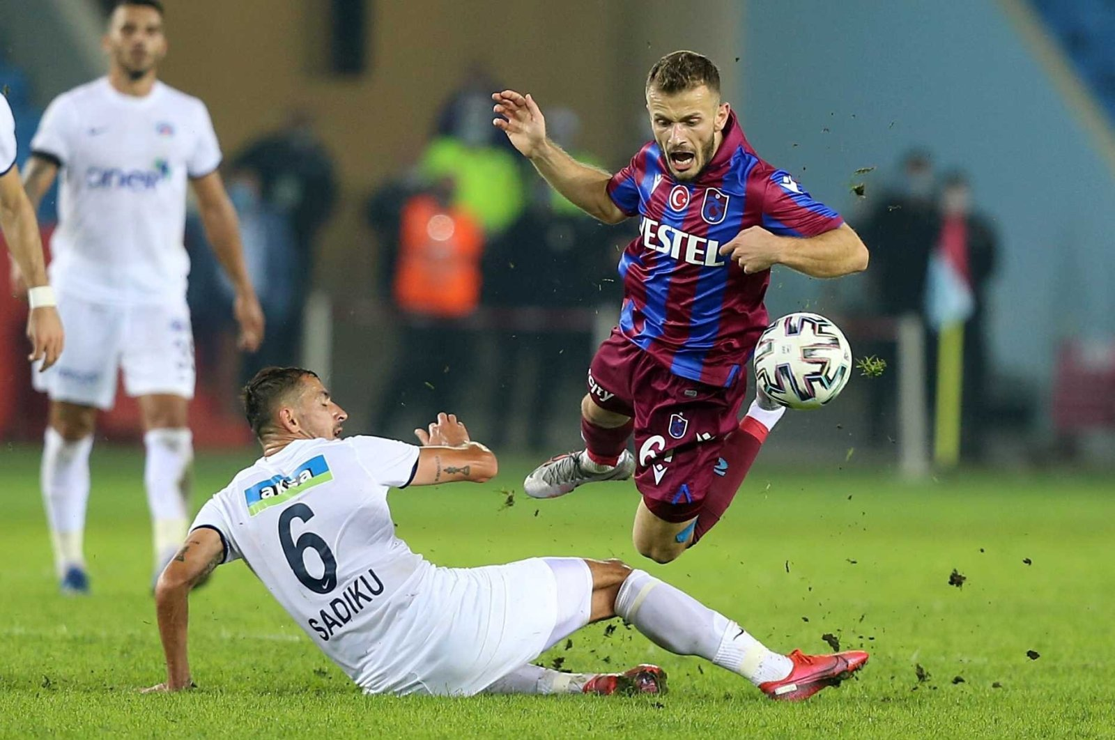 Kasımpaşa's Loret Sadıku tackles Trabzonspor's Abdulkadir Parmak at the Şenol Güneş Stadium in northeastern Trabzon province on Oct. 31, 2020. (AA Photo)