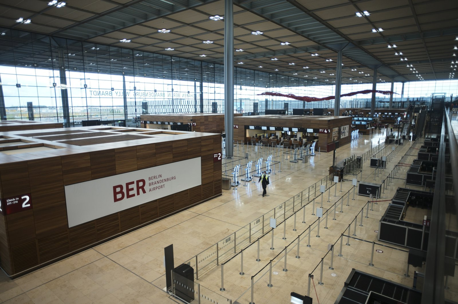"People walk through the Terminal 1 of the new Berlin-Brandenburg-Airport ""Willy Brandt"" near Berlin in Schoenefeld, Germany, Oct. 27, 2020. (AP Photo)"