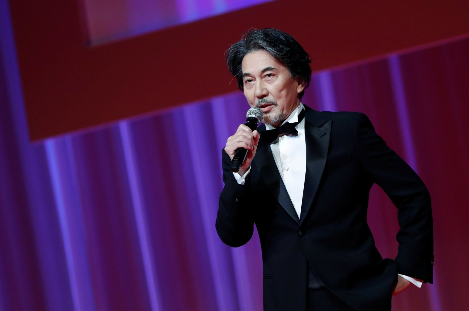 Actor and the 33rd Tokyo International Film Festival ambassador Koji Yakusho delivers a speech during the opening ceremony of the festival, amid the coronavirus disease outbreak, in Tokyo, Japan on Oct. 31, 2020. (Reuters Photo)