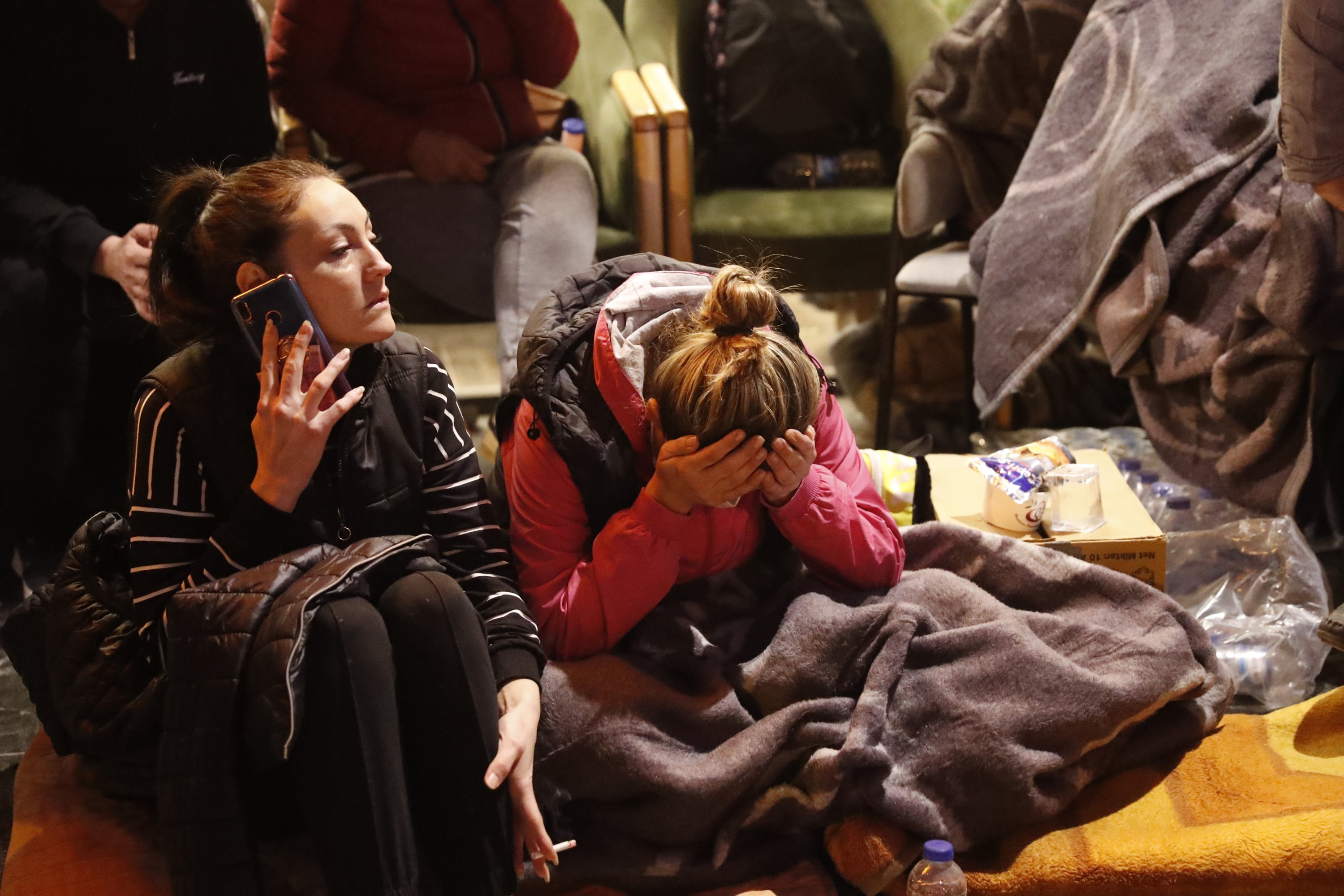 Local residents, staying outdoors for fear of aftershocks, sit in a coffee shop in Izmir, Turkey, Oct. 31, 2020. (AP Photo)