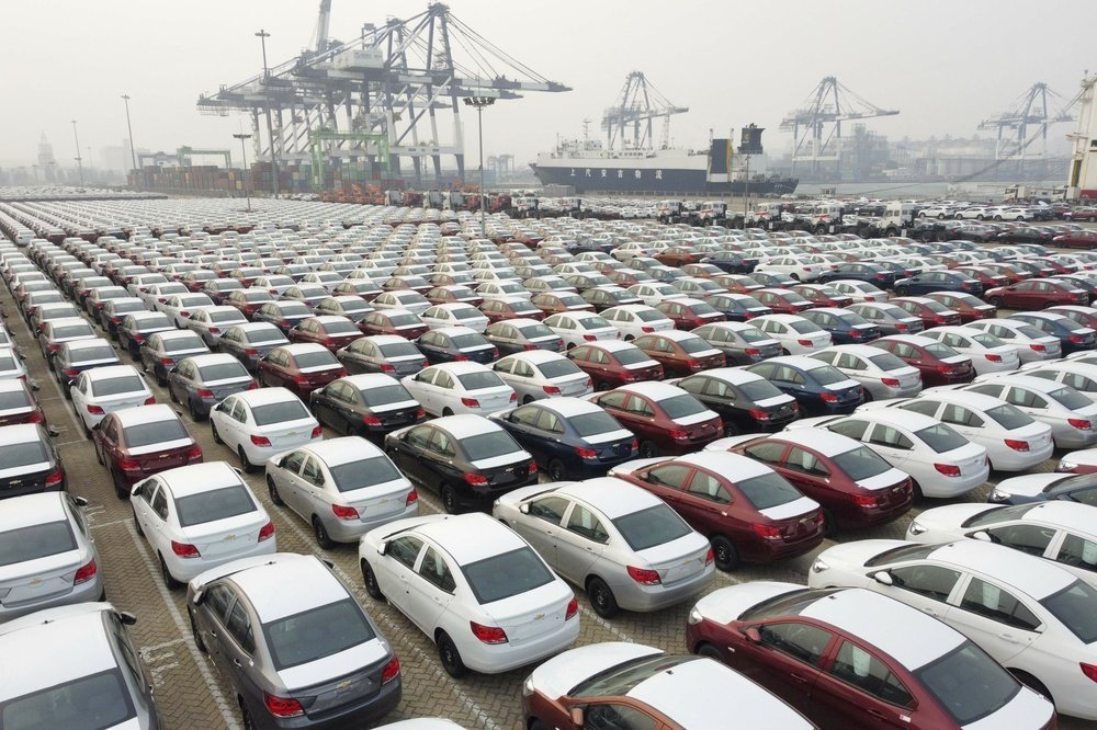 New cars wait to be transported from a port Yantai in east China's Shandong province Wednesday, Oct. 21, 2020. (Chinatopix Via AP)