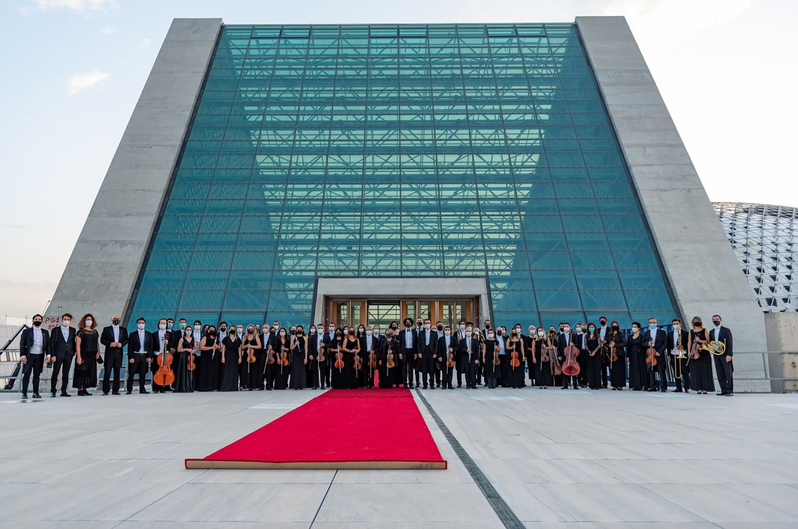 Members of the Presidential Symphony Orchestra stand in front of the new CSO building, Ankara, Turkey.