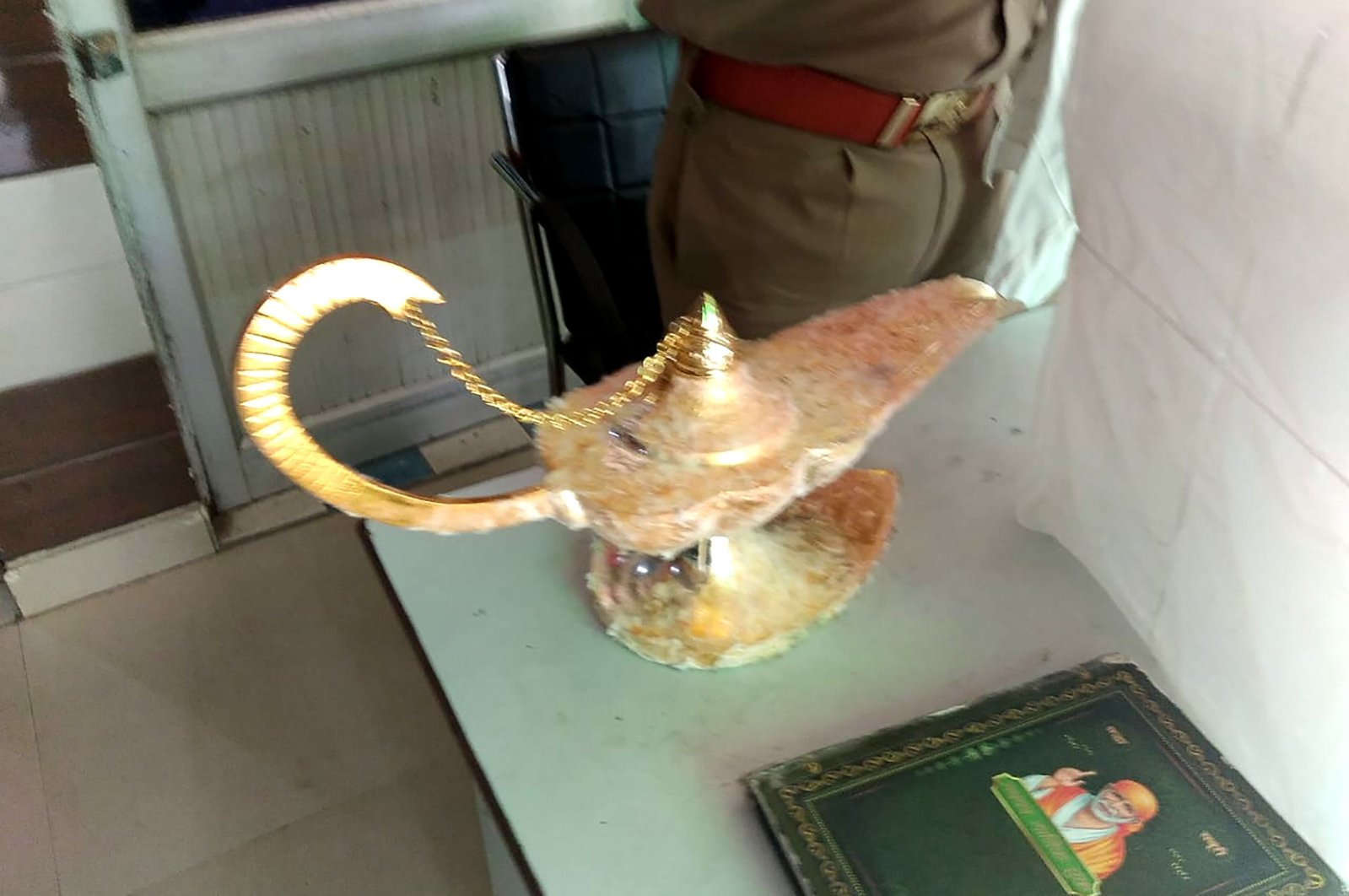 """The lamp that was allegedly sold for $93,000 with the claim that it had magical powers, as described in the popular folk tale """"Aladdin,"""" at the Brahampuri police station in New Delhi, Oct. 29, 2020. (Uttar Pradesh Police Photo via AFP)"""