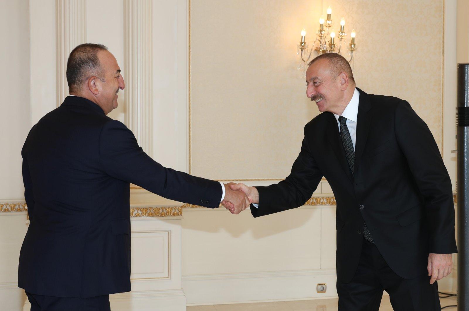 Foreign Minister Mevlüt Çavuşoğlu meets with Azerbaijan's President Ilham Aliyev during an official visit to Baku, Azerbaijan, Nov. 1, 2020. (AA Photo)