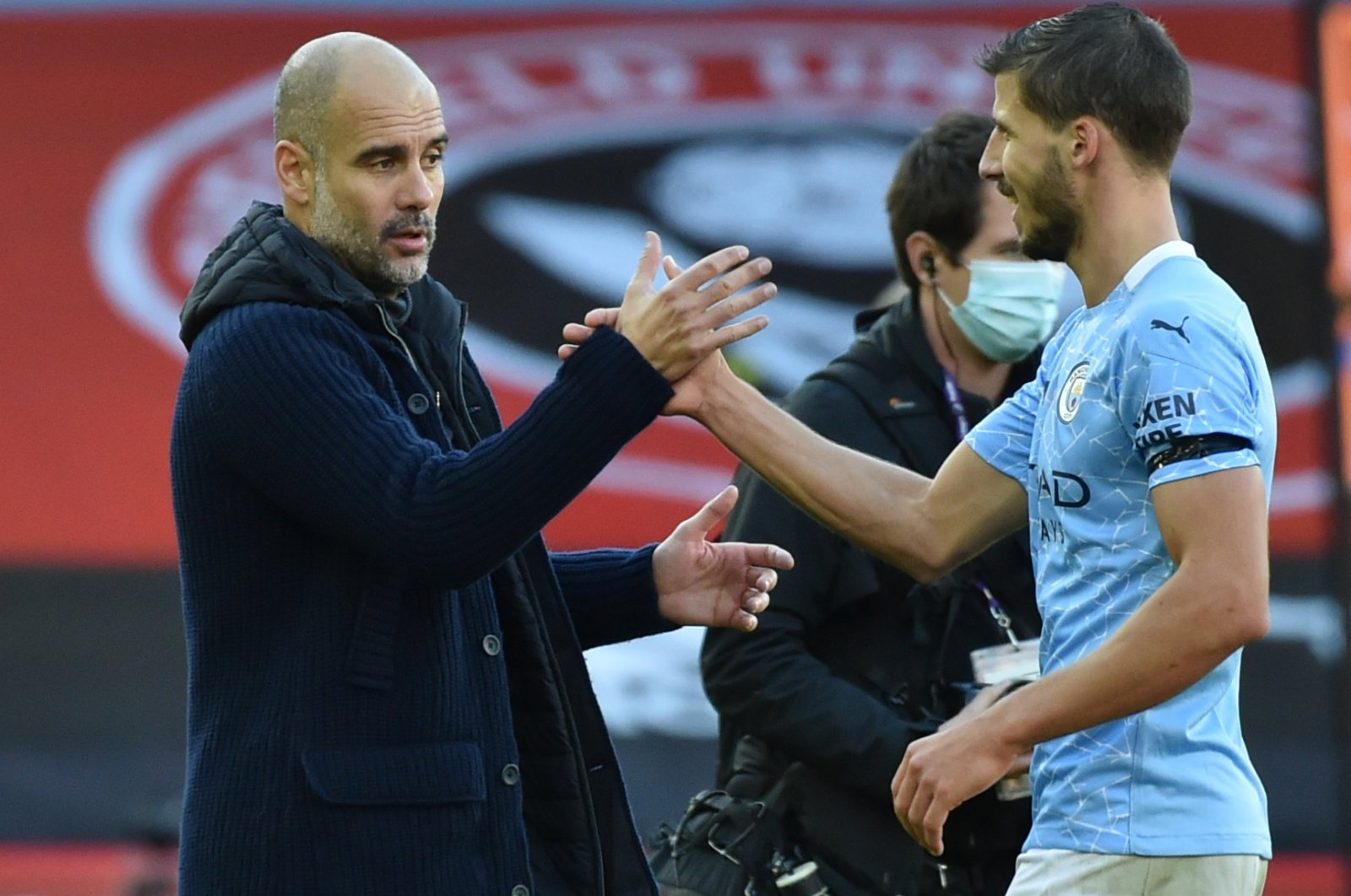 Manchester City Manager Pep Guardiola (L) celebrates with Ruben Dias after the Premier League match against Sheffield United, in Sheffield, England, Oct. 31, 2020. (AFP Photo)