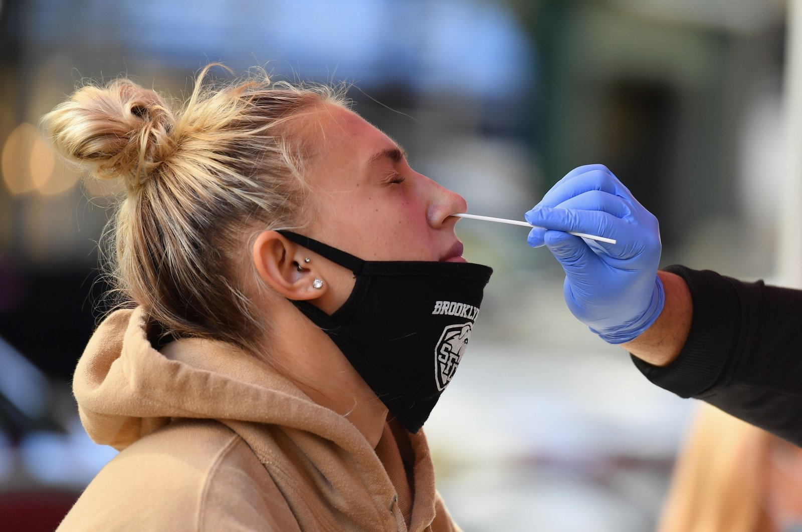 A medical worker takes a nasal swab sample from a student to test for COVID-19 at the Brooklyn Health Medical Alliance urgent care pop-up testing site as infection rates spike in New York City, U.S., Oct. 8, 2020. (AFP Photo)