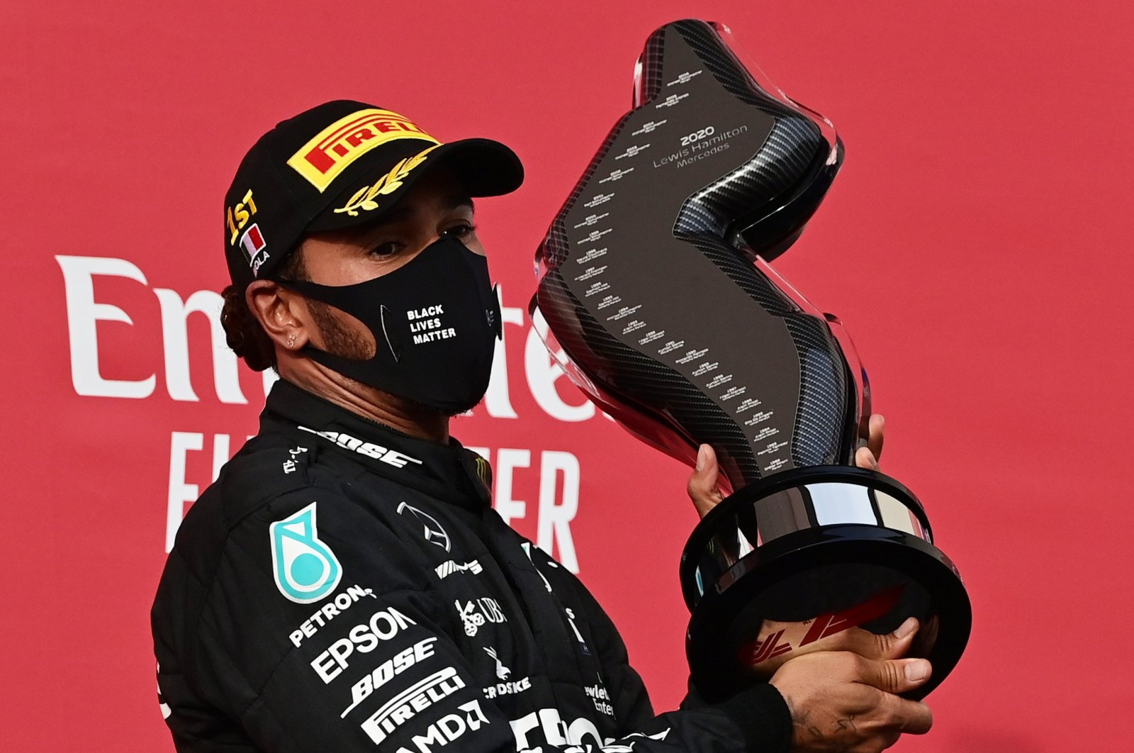 Mercedes' Lewis Hamilton celebrates on the podium with the trophy after winning the Emilia Romagna Grand Prix, Imola, Italy, Nov. 1, 2020. (Reuters Photo)