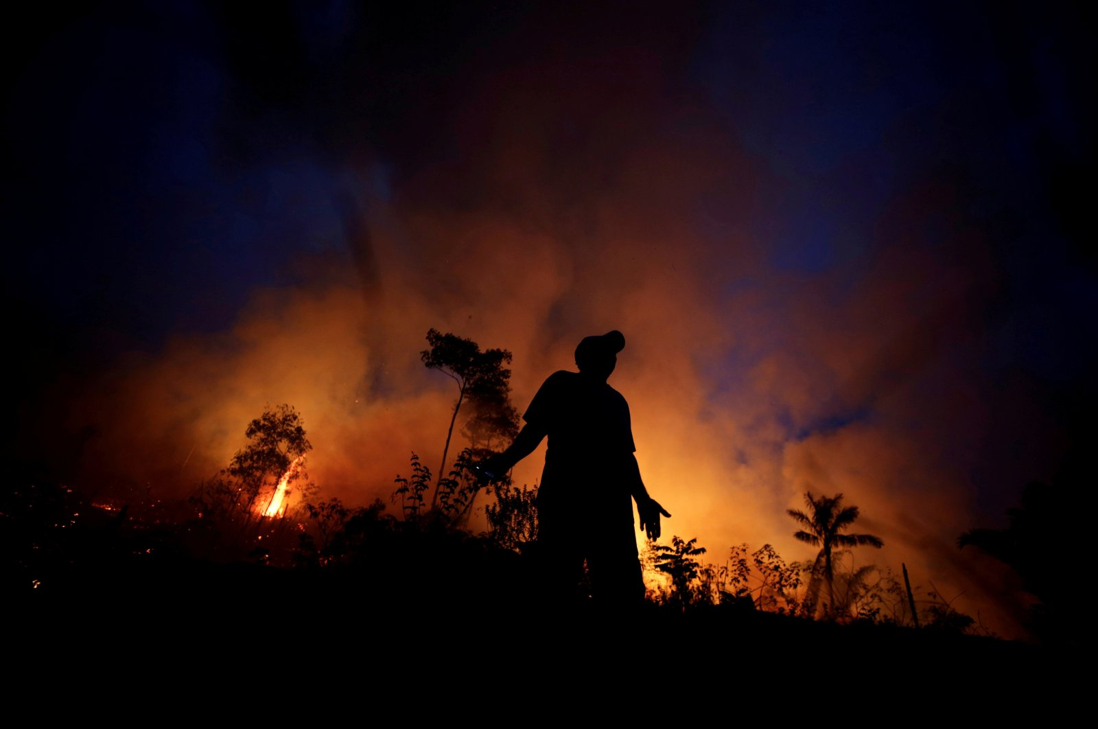 A fire burns as back burning is used to create a firebreak to stop the progress of a fire at a tract of the Amazon jungle in Apui, Amazonas State, Brazil, Aug. 11, 2020. (Reuters Photo)
