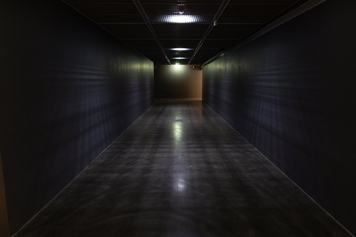 "Deniz Gül's ""Passage"" appears as disconcerting with its dim light and enigmatic structure.  (Courtesy of YKY)"