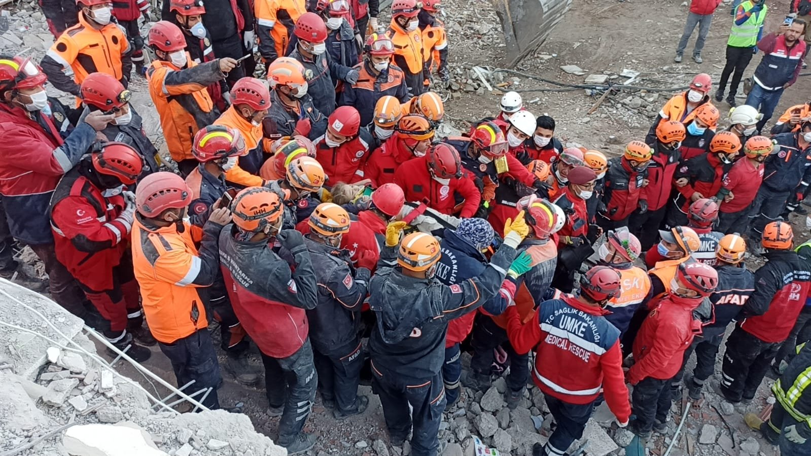 Rescue workers carry 3-year-old Elif Perinçek from the rubble, in Izmir, western Turkey, Nov. 2, 2020. (AA Photo)
