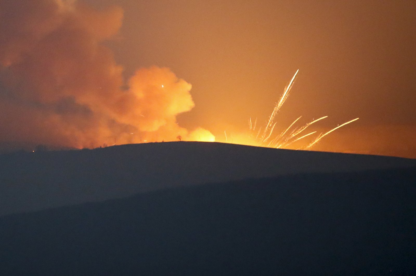 Explosions are seen in the mountains during fighting between Armenian and Azerbaijani forces outside Stepanakert in the occupied region of Nagorno-Karabakh, Azerbaijan, Nov. 1, 2020. (AP Photo)