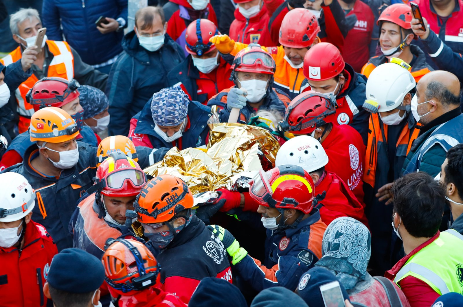 Rescue teams carry 3-year-old Elif Perinçek after she was pulled from the rubble following a 6.6 magnitude earthquake, Izmir, Turkey, Nov. 2, 2020. (AA Photo)