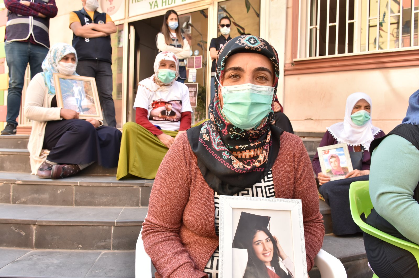 Türkan Mutlu holds onto her daughter Ceylan's picture during a sit-in protest in front of the HDP headquarters in Diyarbakır, Nov. 2, 2020. (AA)