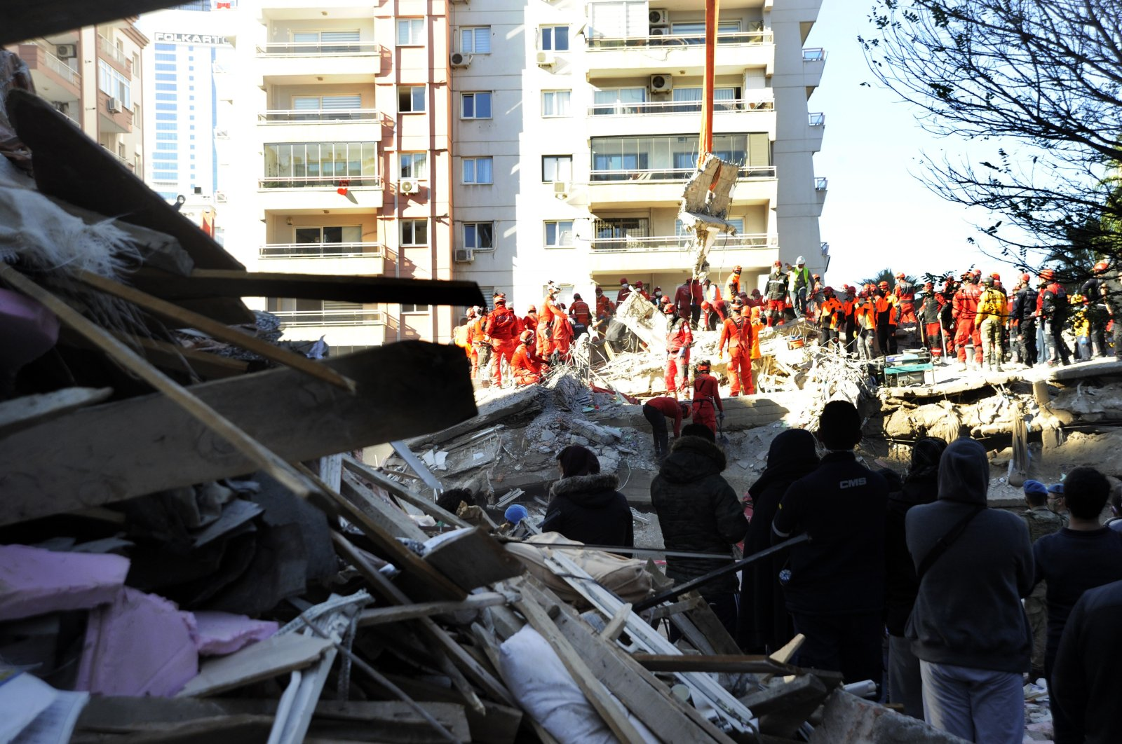 Rescue workers remove debris of an apartment building in Izmir, western Turkey, Nov. 2, 2020. (İHA Photo)
