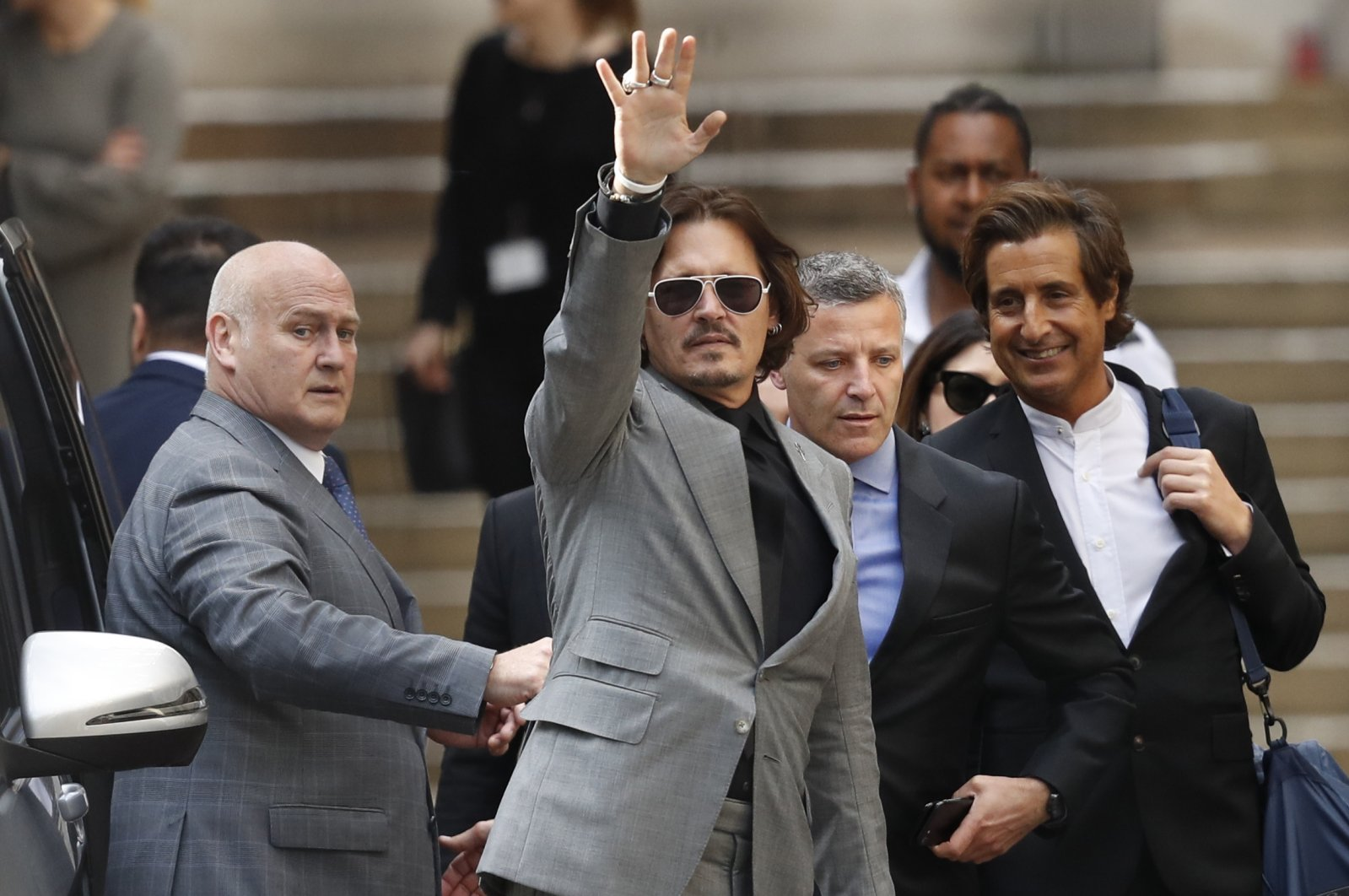 U.S. actor Johnny Depp waves as he leaves after the end of the trial at the High Court in London, July 28, 2020. (AP Photo)