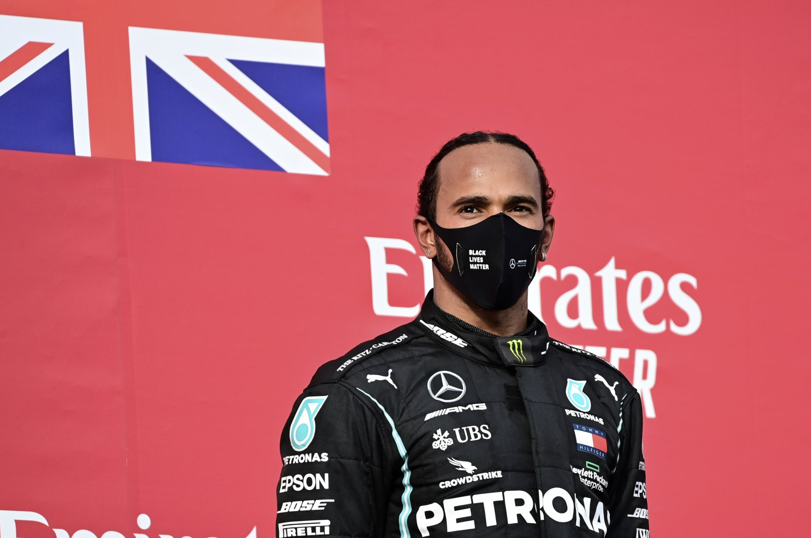 Mercedes driver Lewis Hamilton stands on the podium after winning the F1 Emilia Romagna GP, in Imola, Italy, Nov.1, 2020. (AP Photo)