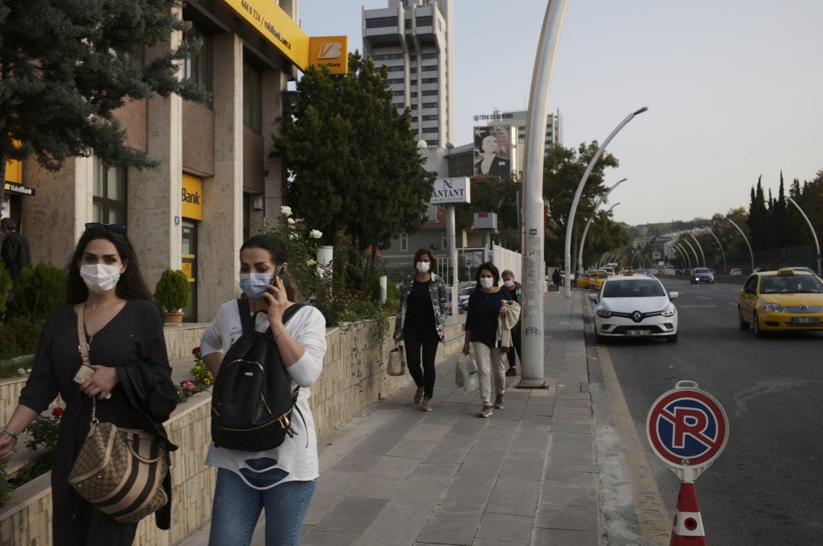 People wearing masks against the coronavirus, in the capital Ankara, Turkey, Oct. 27, 2020. (AP Photo)