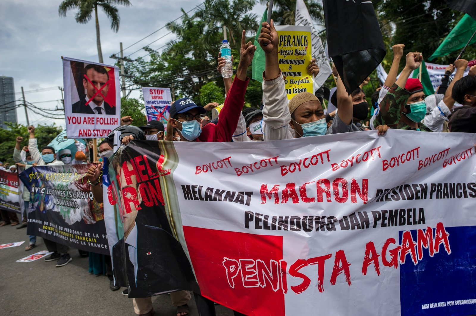 Muslim protesters attend a demonstration against French President Emmanuel Macron in Surabaya, Indonesia, Nov. 2, 2020. (AFP Photo)