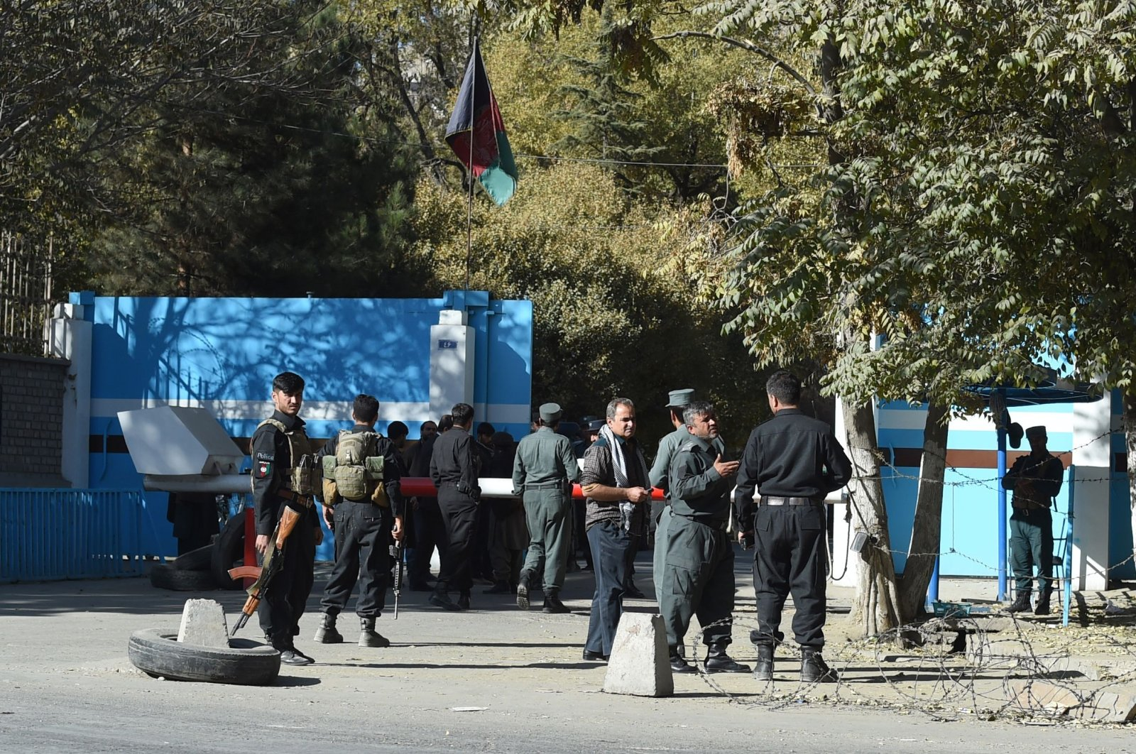 Police stand guard at an entrance gate of Kabul University in Kabul, Afghanistan, Nov. 2, 2020. (AFP Photo)