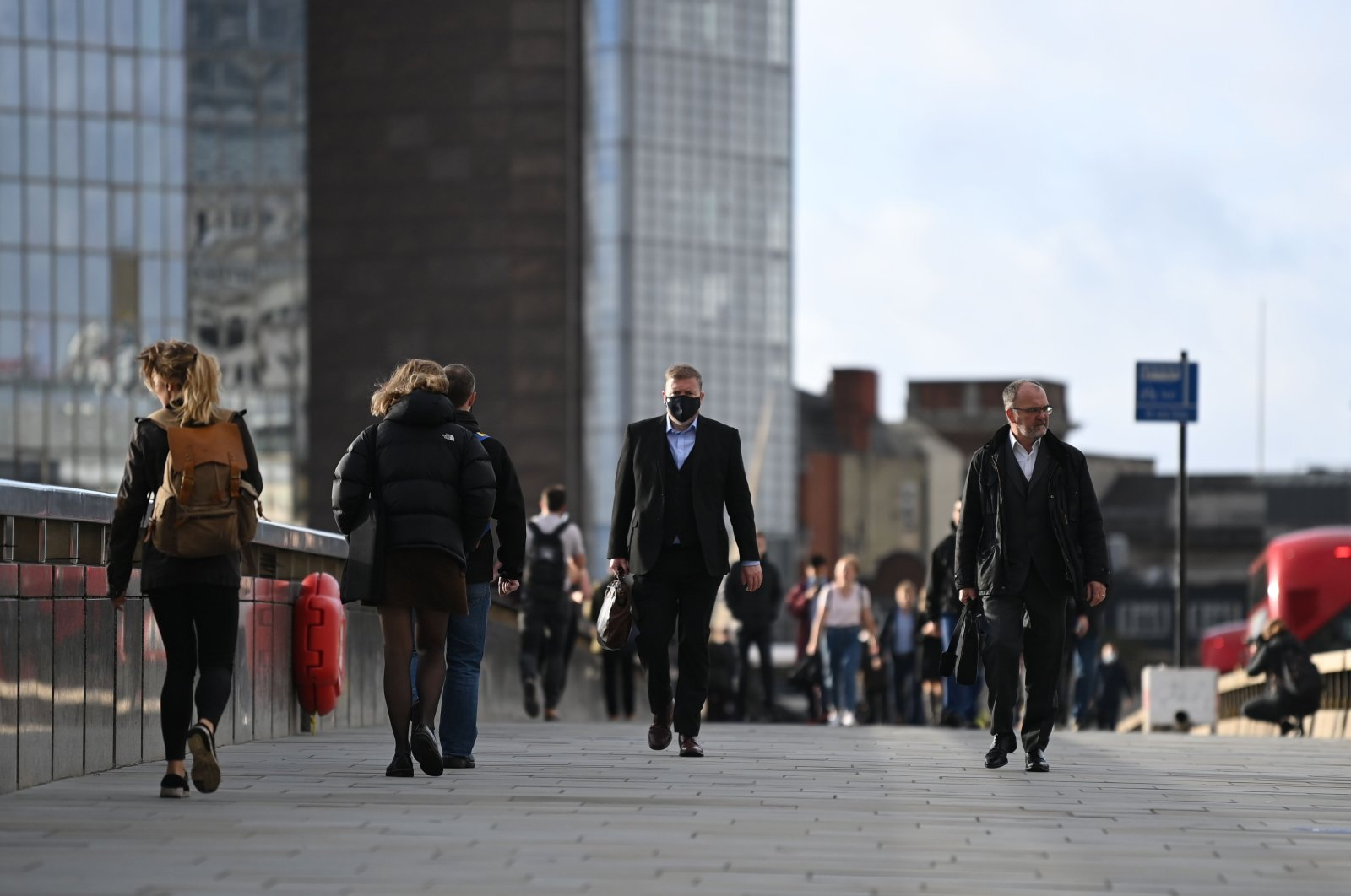 Commuters walk over London Bridge during the morning rush hour in central London, U.K., Nov. 2, 2020. (AFP Photo)