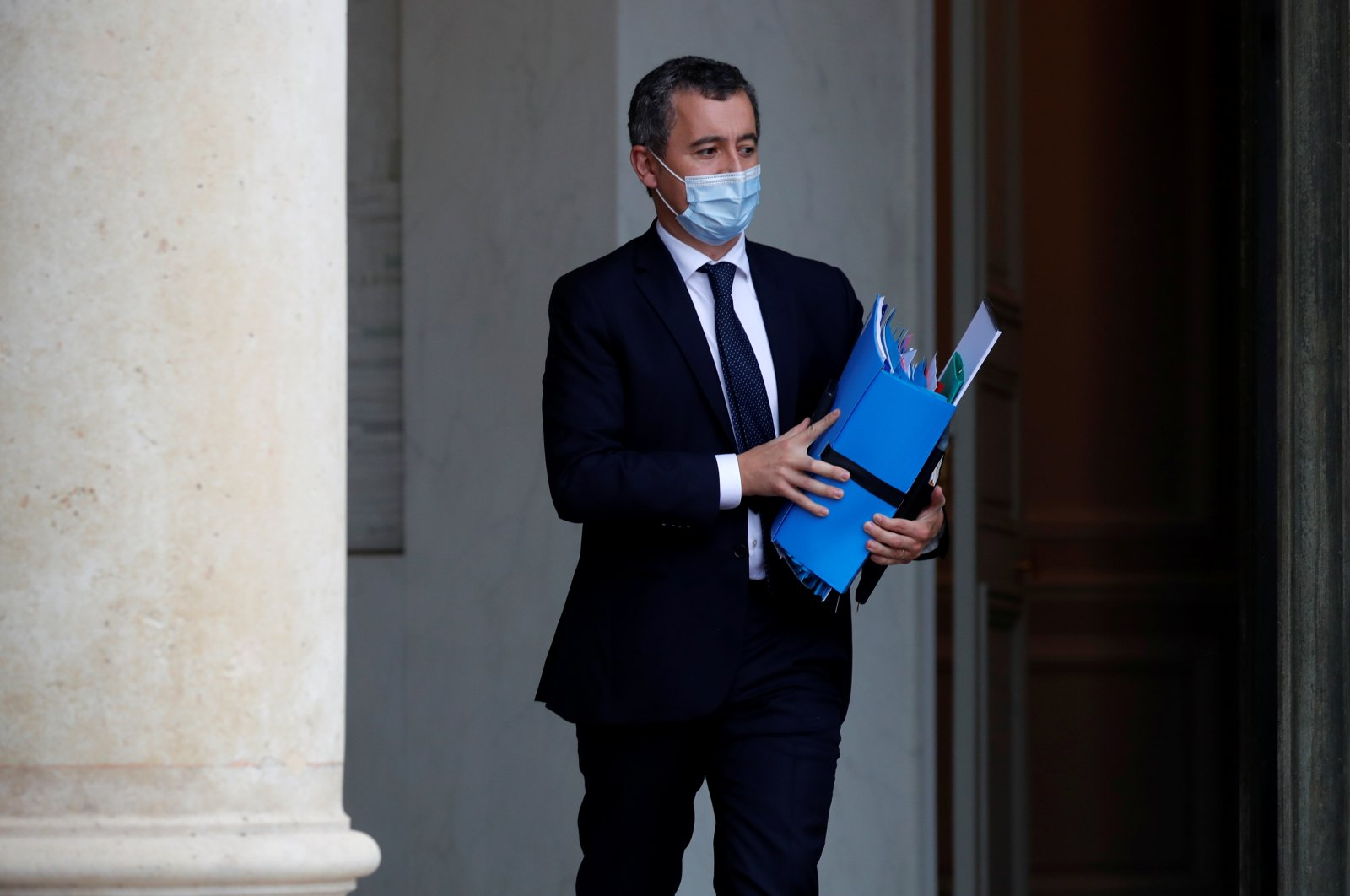 French Interior Minister Gerald Darmanin, wearing a protective mask, leaves following the weekly Cabinet meeting at the Elysee Palace in Paris, France, Oct. 28, 2020. (Reuters Photo)
