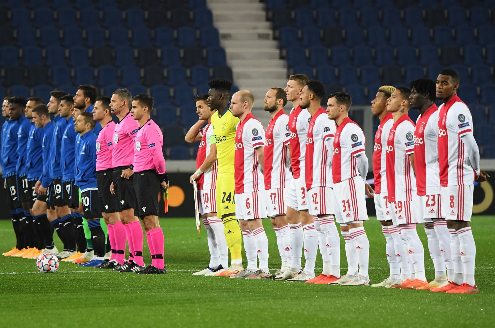 Match officials, Atalanta and Ajax players line up before a Champions League match at Stadio Atleti Azzurri, in Bergamo, Italy, Oct. 27, 2020. (Reuters Photos)
