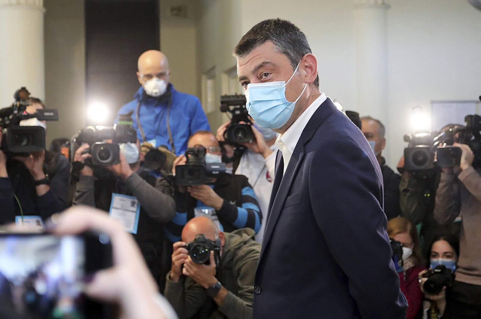 Georgia's Prime Minister Giorgi Gakharia, wearing a mask to help curb the spread of the coronavirus, speaks to the media after voting at a polling station during the parliamentary elections in Tbilisi, Georgia, Oct. 31, 2020. (Georgia's Prime Minister Press office via AP)