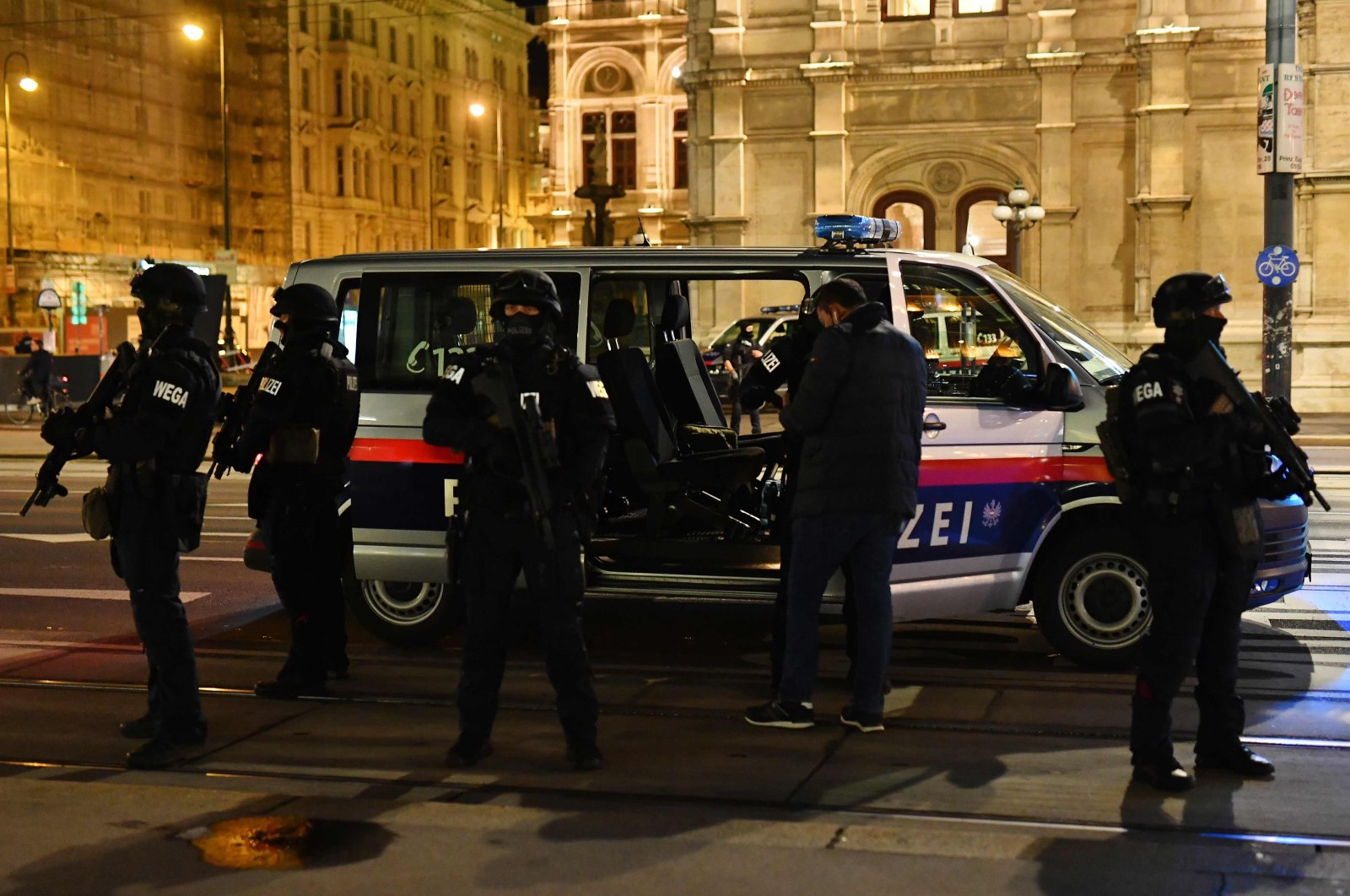 Armed police officers stand outside of a police vehicle near the State Opera in the center of Vienna following a terror attack, Nov. 2, 2020. (AFP Photo)