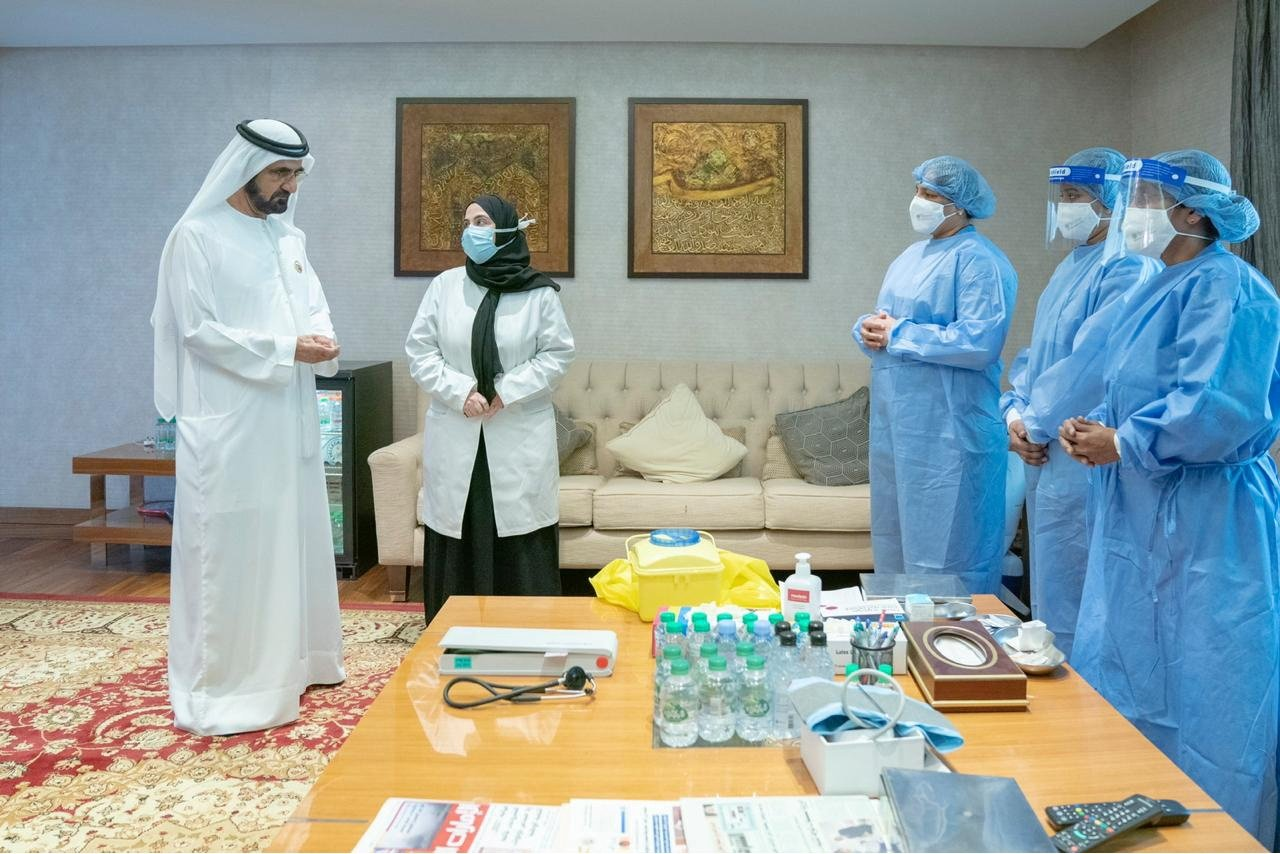 Dubai's ruler and Prime Minister of the United Arab Emirates (UAE)Sheikh Mohammed bin Rashid Al Maktoum talks to staff before he receives COVID-19 vaccine in Dubai, UAE, Nov. 3, 2020. (Reuters Photo)