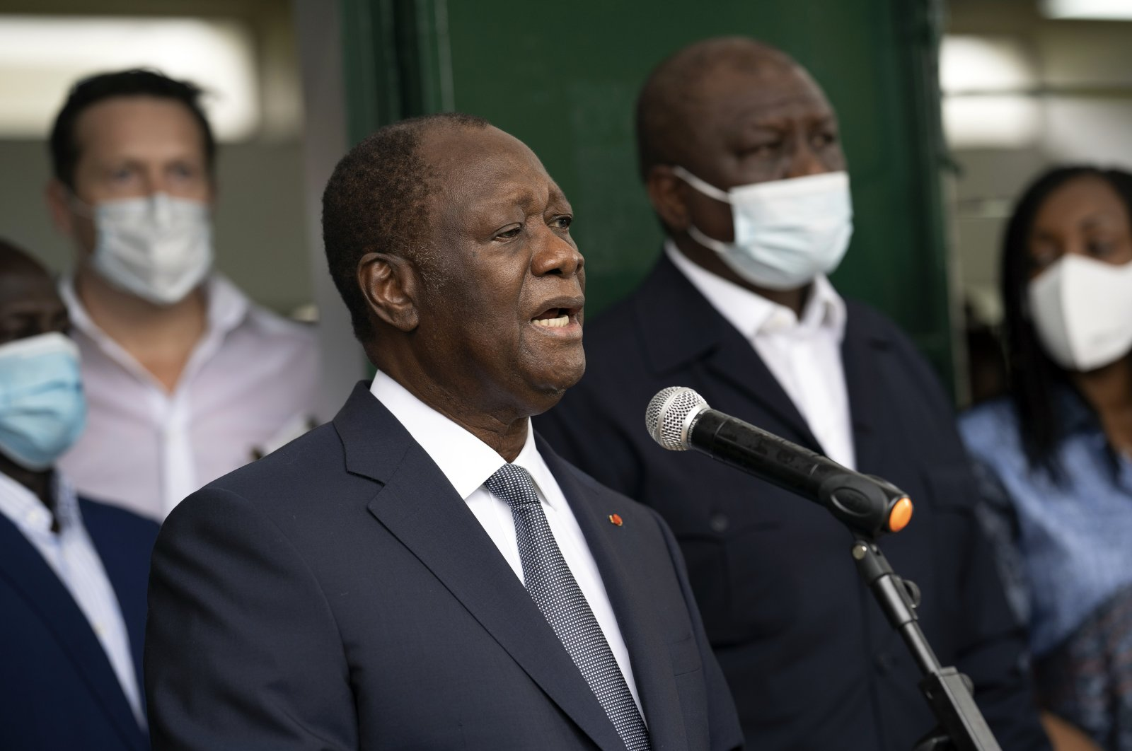 Ivory Coast President Alassane Ouattara speaks to journalists after voting at a polling station during presidential elections in Abidjan, Ivory Coast, Saturday, Oct. 31, 2020. (AP Photo)