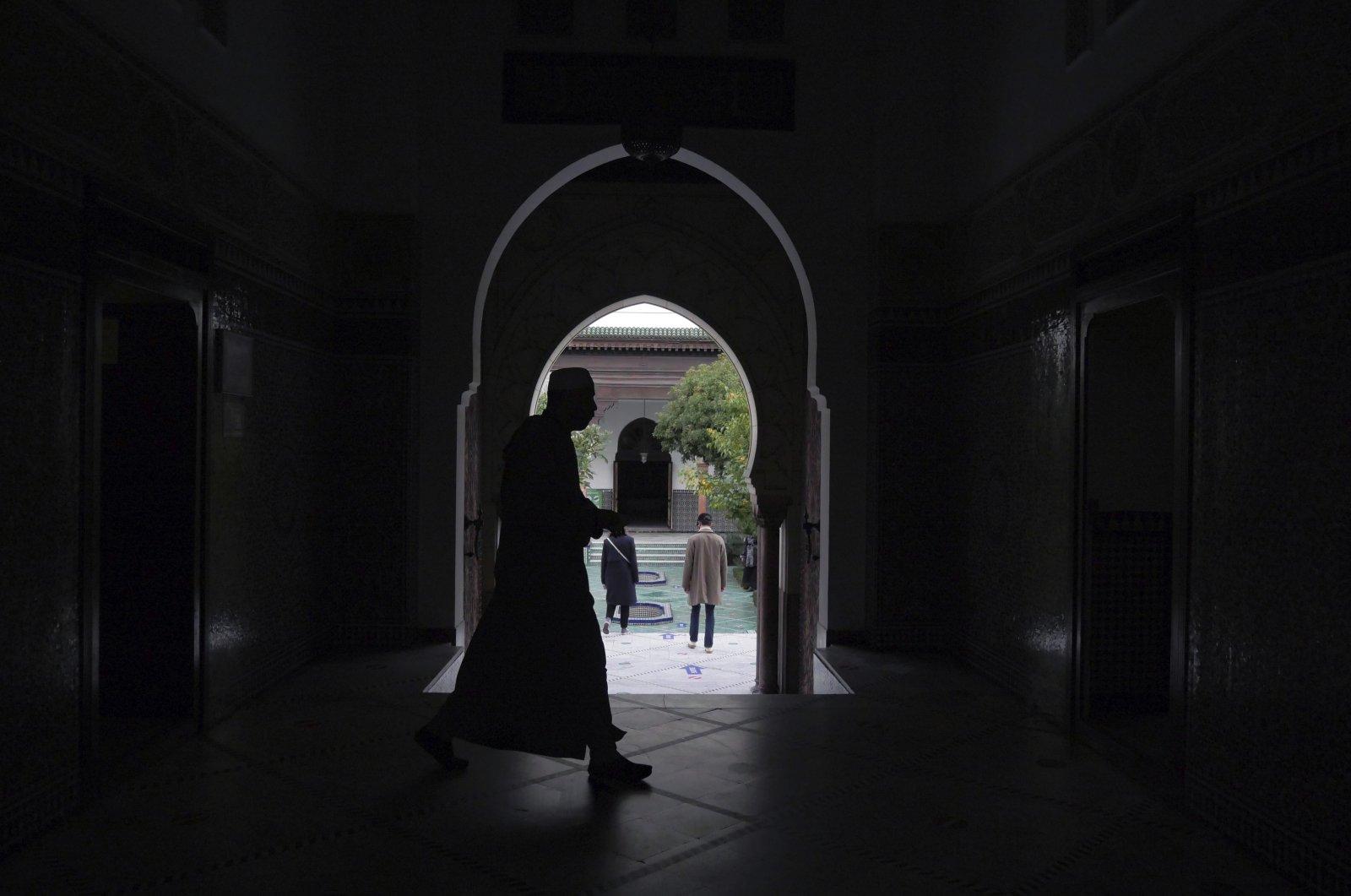 A Muslim walks inside Grand Mosque of Paris, Paris, France, Oct. 29, 2020. (AP Photo)