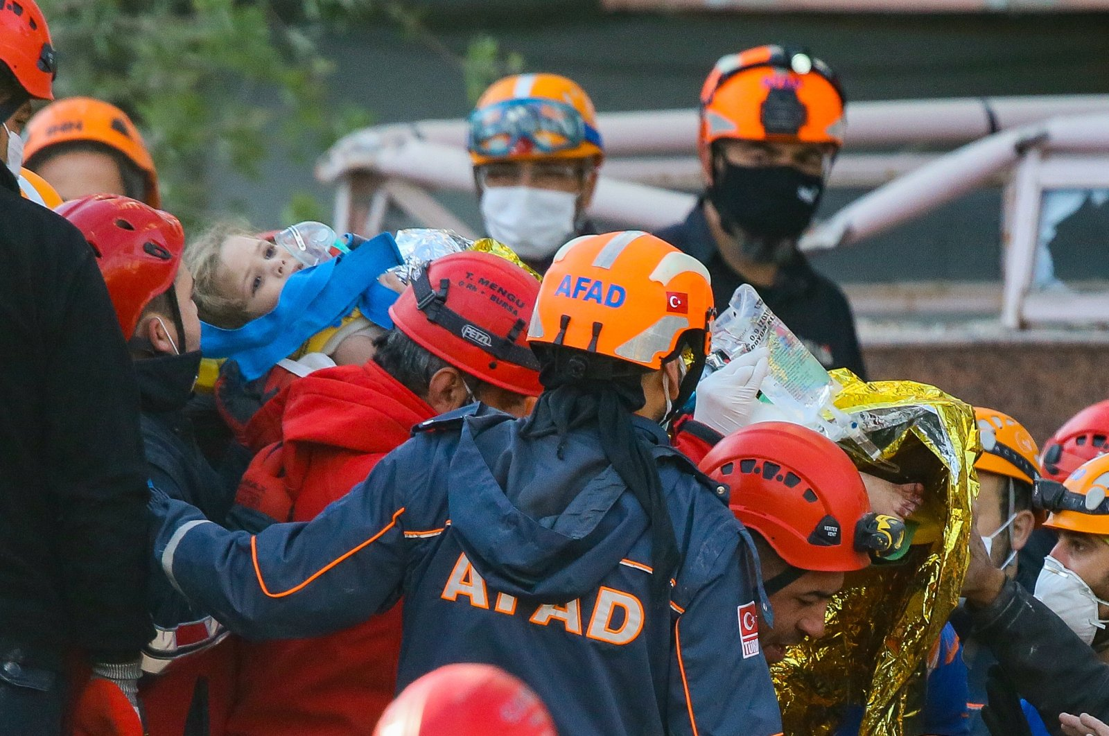 Rescue teams carry 4-year-old Ayda Gezgin after she was rescued from the rubble in the Bayraklı district 91 hours after an earthquake, in Izmir, western Turkey, Nov. 3, 2020. (AA Photo)