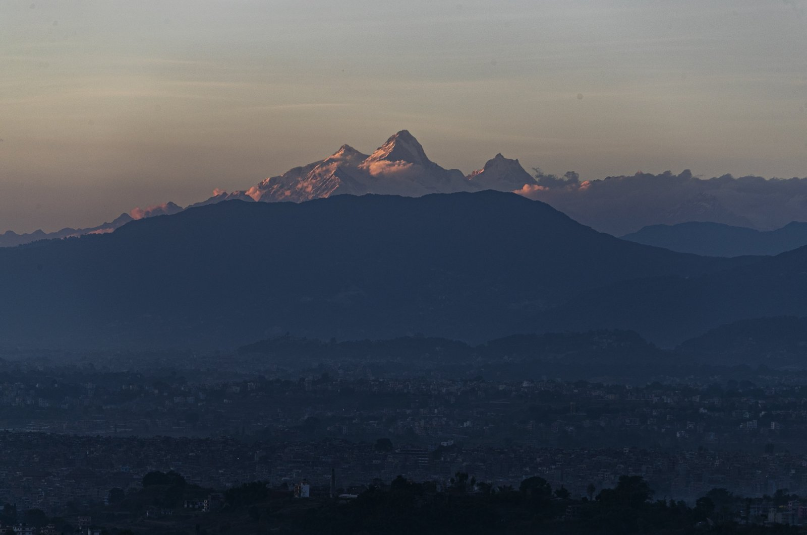 Himalchuli mountain, (C) and the Manasulu Mountain range, (R) is seen from Bhaktapur, Nepal on Oct. 31, 2020. (AP Photo)