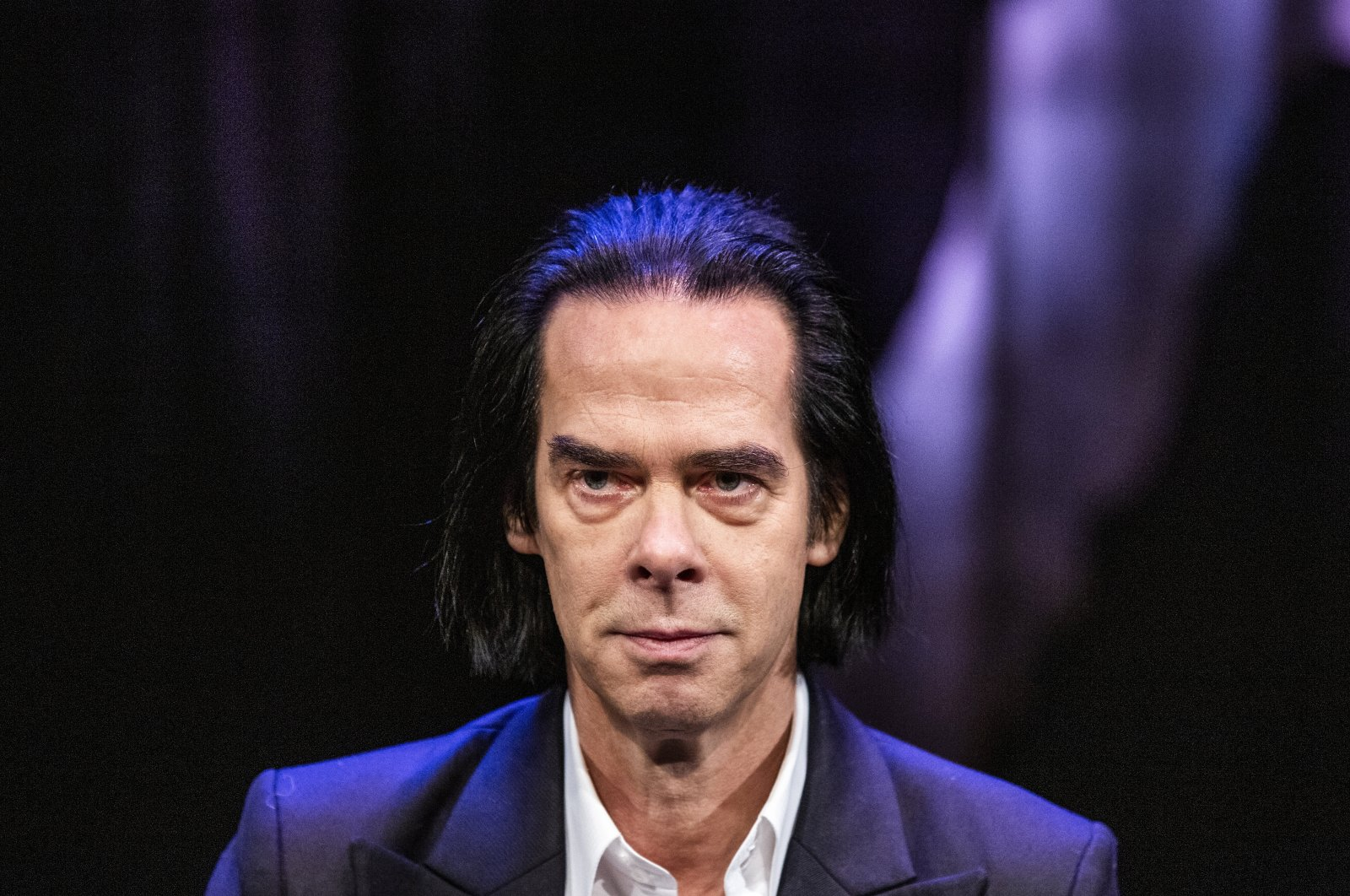 """Australian artist Nick Cave looks on during a press conference to promote his exhibition """"Stranger Than Kindness"""" in Copenhagen, Denmark, Nov. 2, 2020. (AP Photo)"""