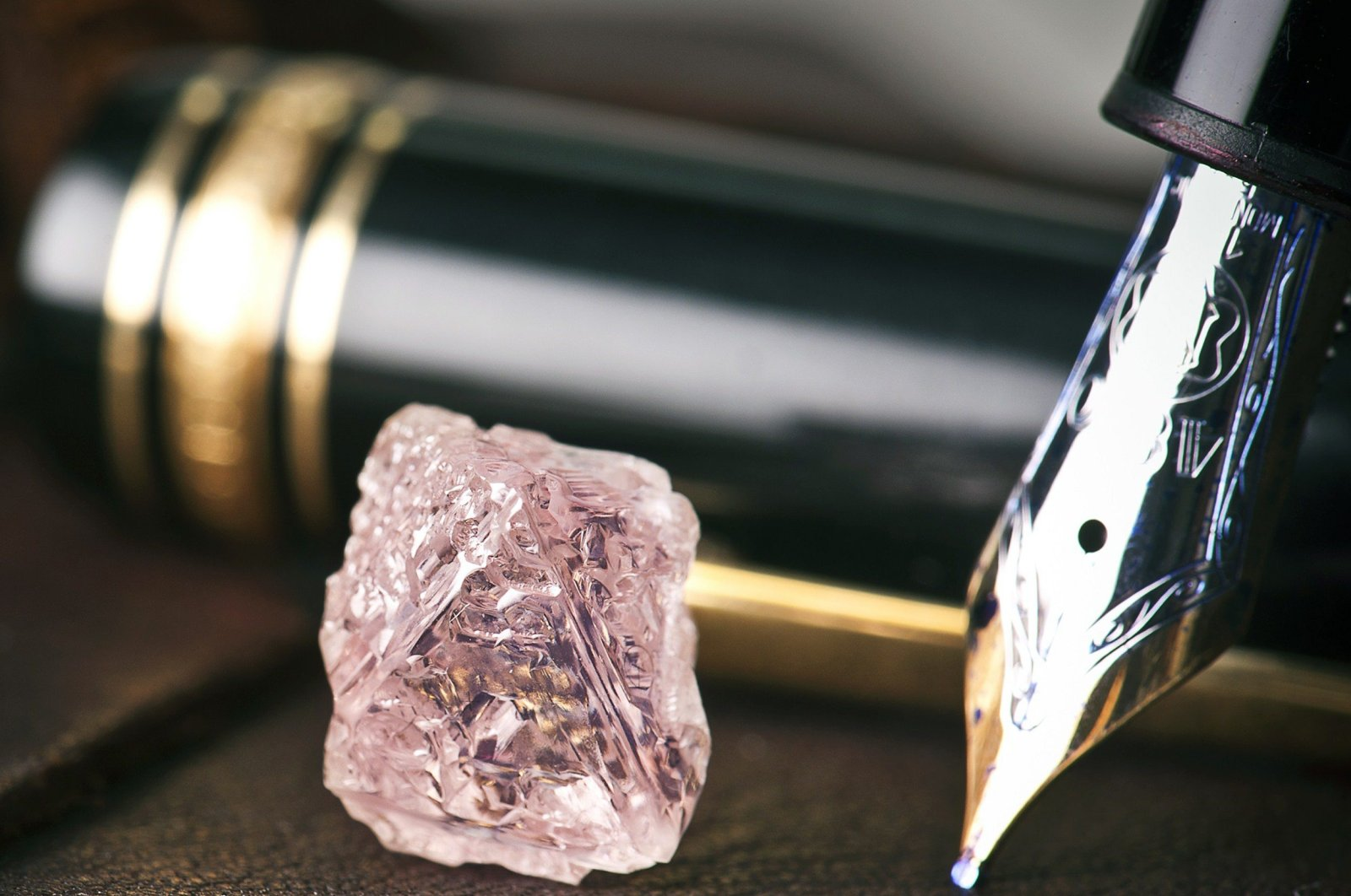 An undated handout photo released by mining giant Rio Tinto shows a 12.76 carat pink diamond – the largest of the rare and precious stones ever found in Australia on Feb. 22, 2012. (AFP Photo)