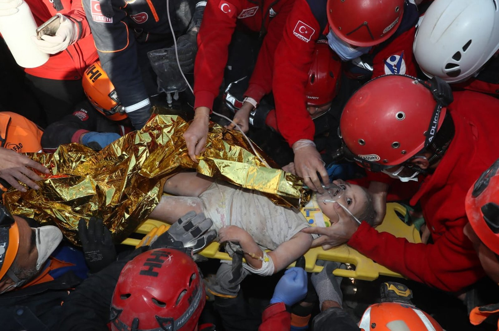 Rescue workers surround Ayda Gezgin, who was pulled from the rubble 91 hours after an earthquake rocked Izmir, western Turkey, Nov. 3, 2020. (AP Photo)