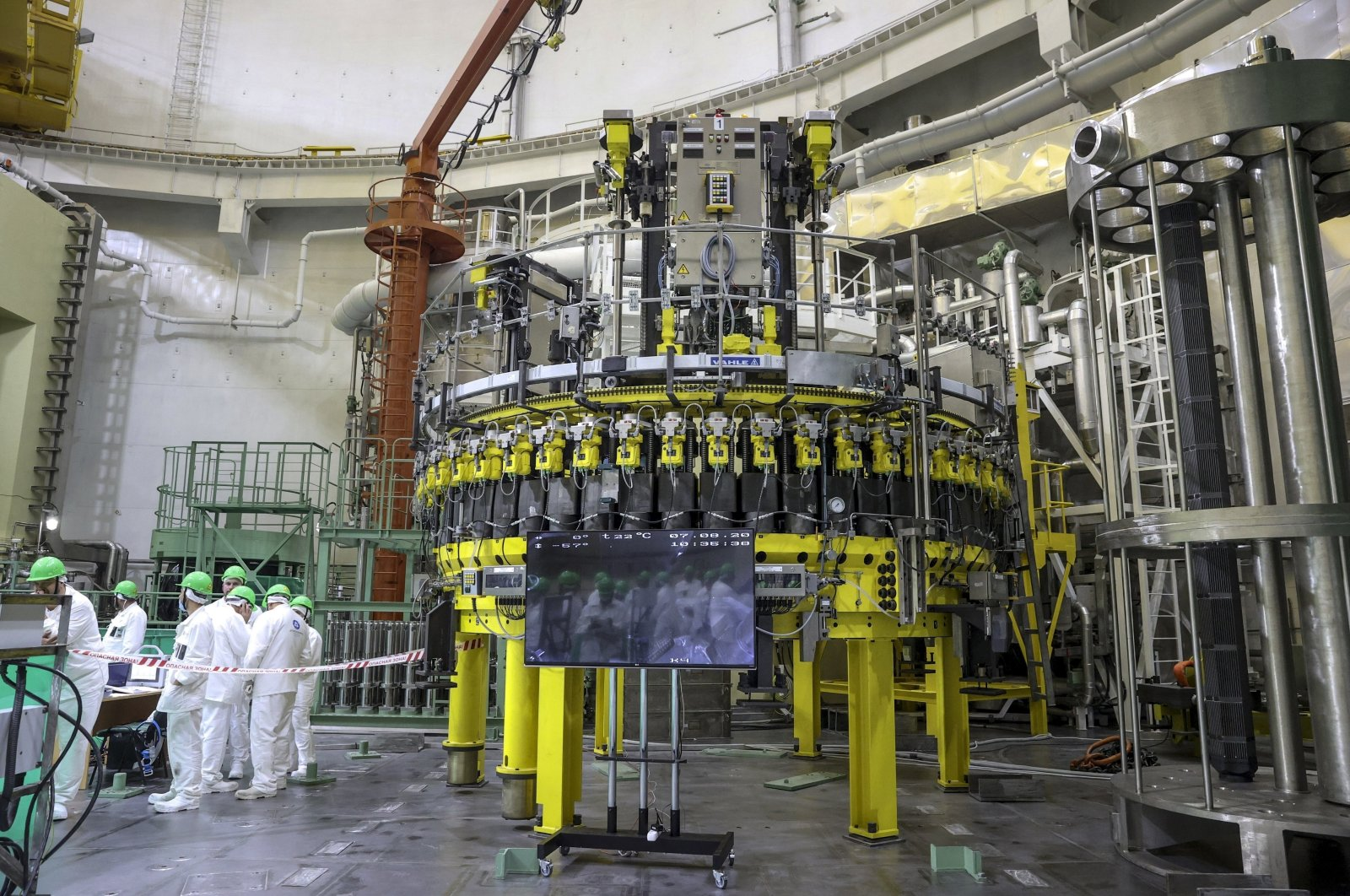Personnel work to begin loading nuclear fuel at Belarus' first nuclear plant which was built by Russia's state nuclear corporation Rosatom, near Astravets, Belarus, Aug. 7, 2020. (BelTa via AP)