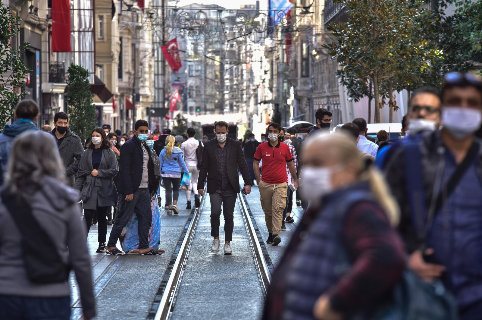 People wearing protective masks walk on Istiklal Avenue, in Istanbul, Turkey, Nov. 2, 2020. (DHA Photo)