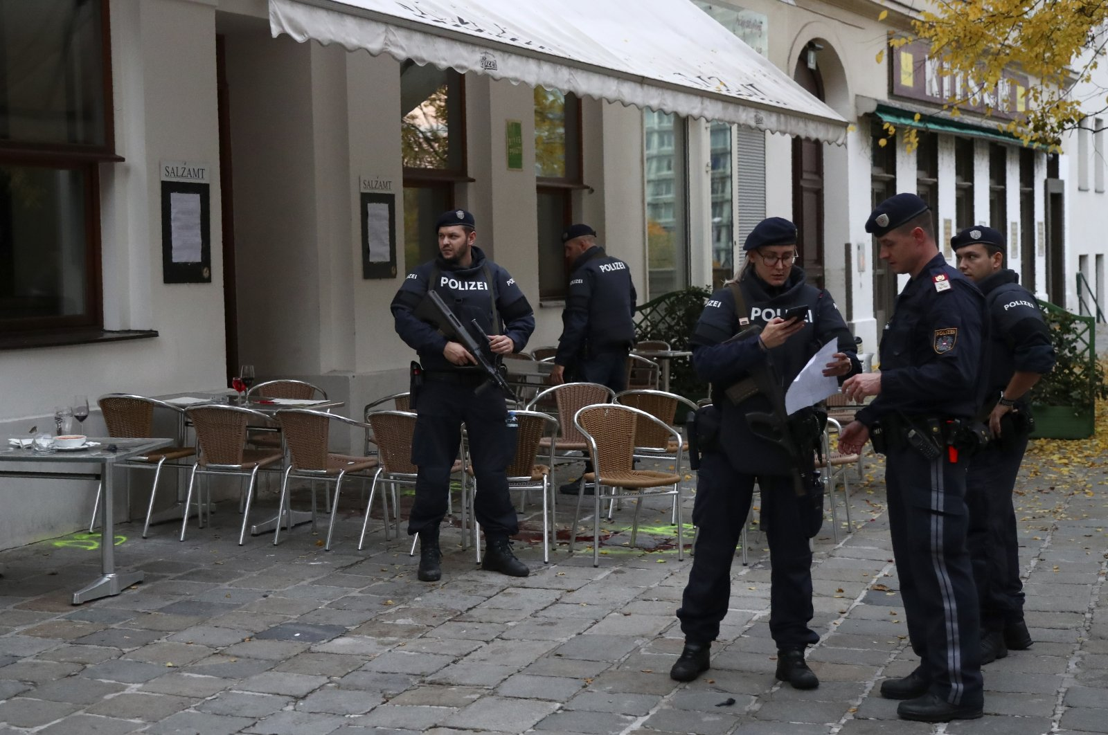 Police officers guard the crime scene at a bar in Vienna, Austria, Nov. 3, 2020. (AP Photo)