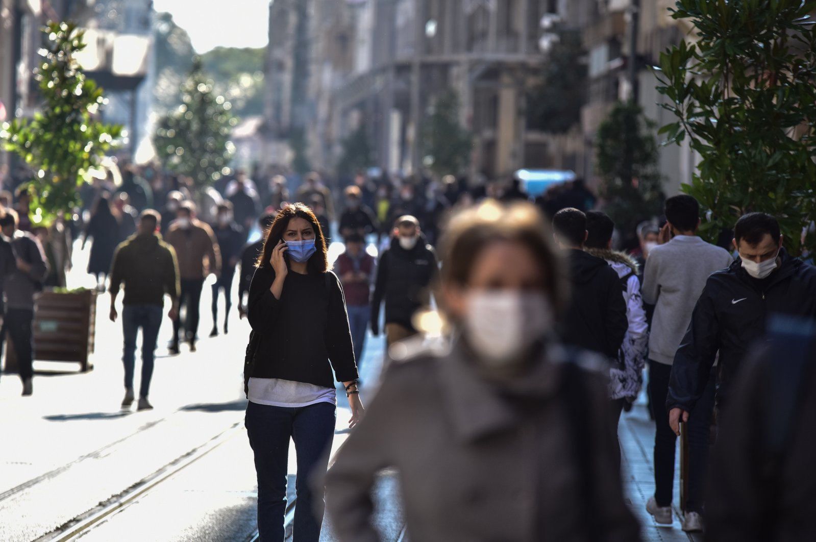 People with face masks walk on Istiklal street near Taksim Square, in Istanbul, Turkey, Nov. 2, 2020. (DHA Photo)