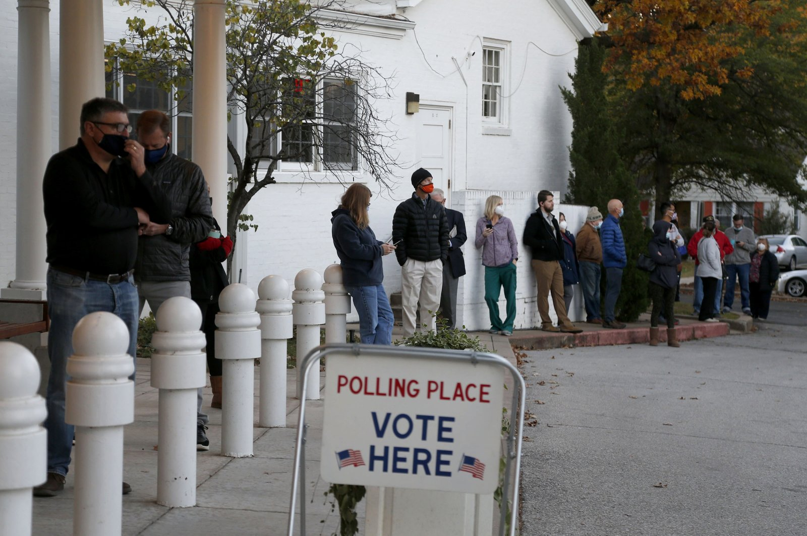 Voters wait in line before the polls open at All Souls Unitarian Church in Tulsa, Okla., U.S., Nov. 3, 2020. (AP Photo)
