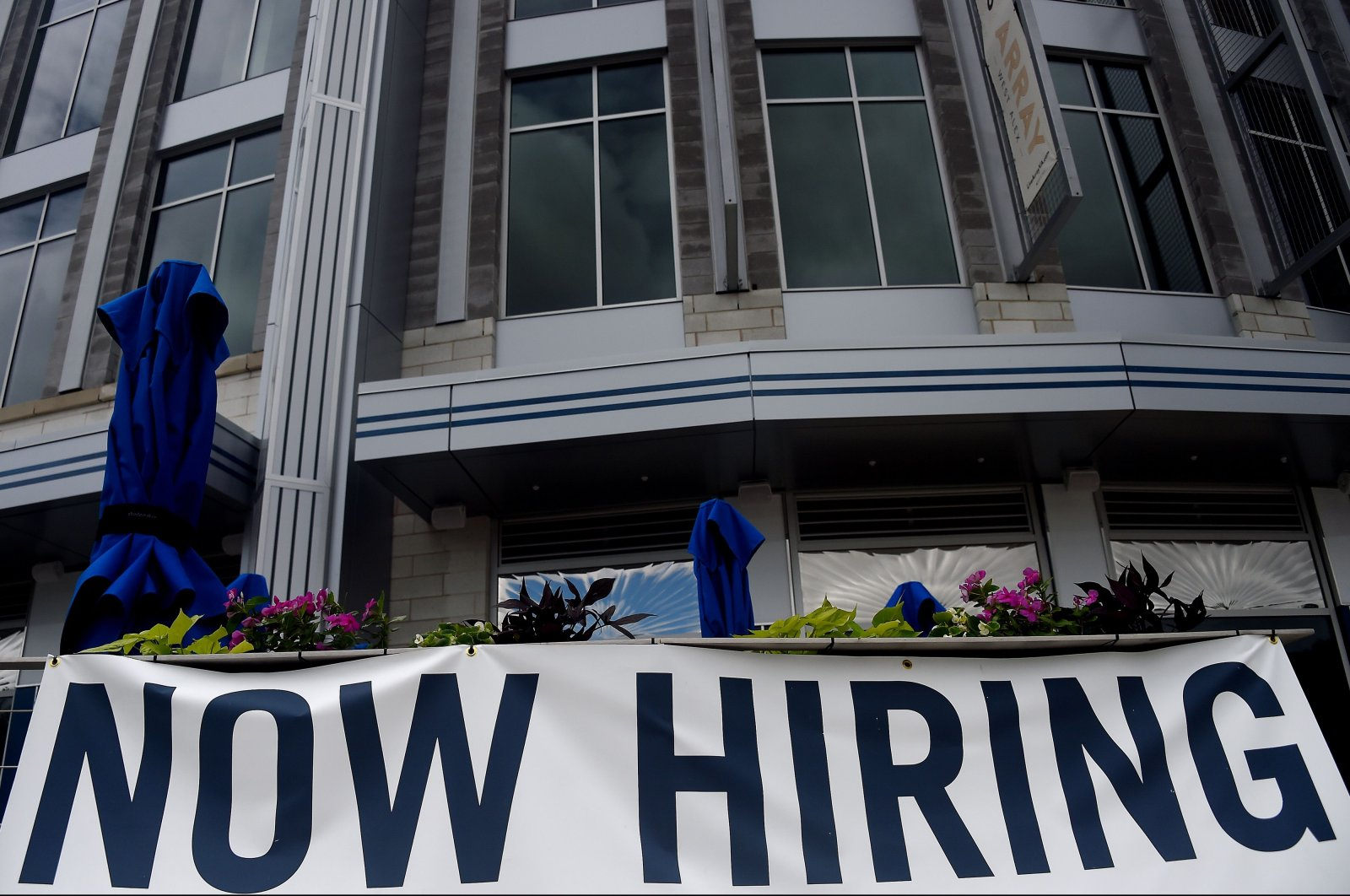 """In this file photo taken on August 04, 2020 A restaurant displays a """"Now Hiring"""" sign amid the coronavirus pandemic in Arlington, Virginia. (AFP Photo)"""