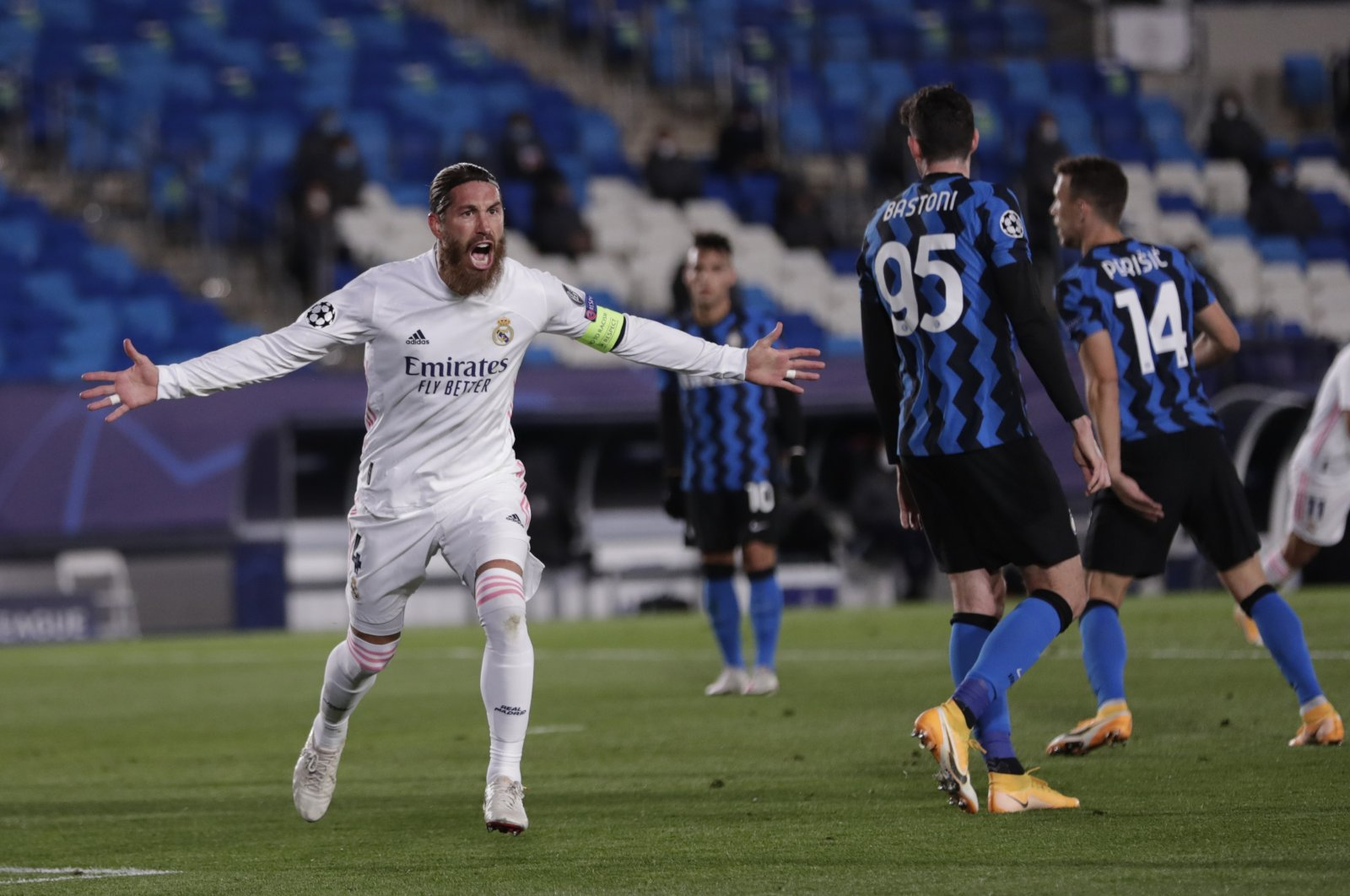 Real Madrid's Sergio Ramos celebrates after scoring a goal during the Champions League match against Inter Milan, in Madrid, Spain, Nov. 3, 2020. (AP Photo)