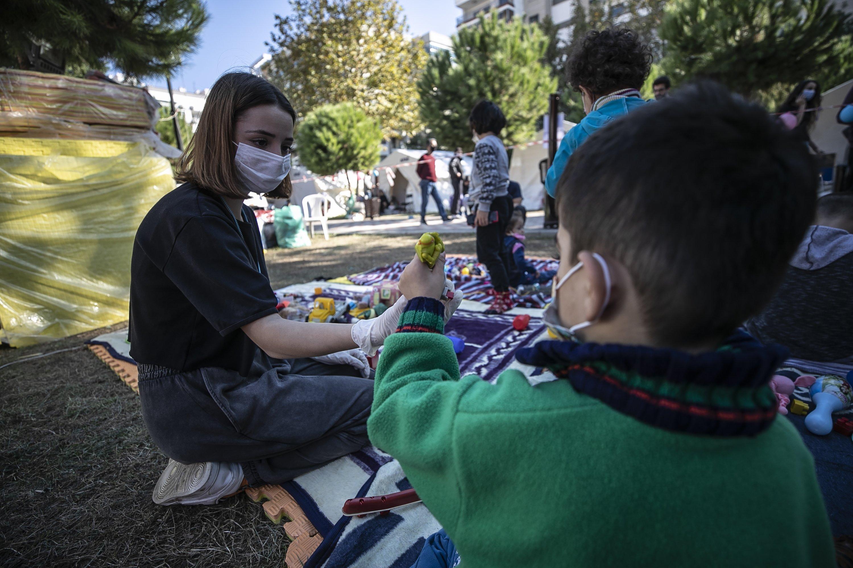 Volunteers cheer up children in Turkey's quake-hit Izmir