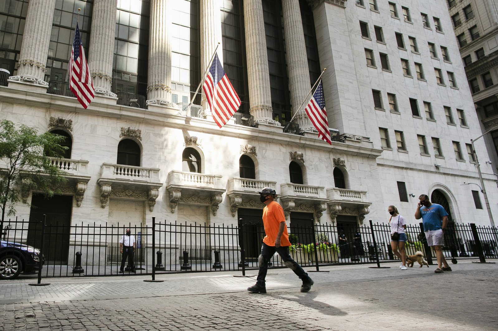 In this July 21, 2020 file photo, people walk by the New York Stock Exchange. (AP Photo)