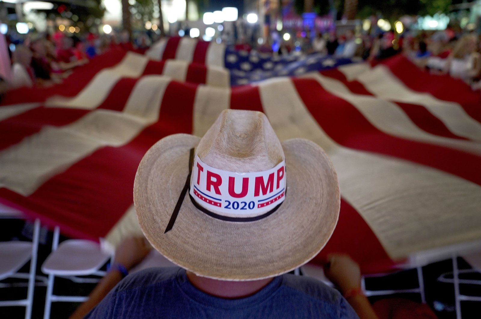 President Trump supporters wave a flag during an election watch party, Tuesday, Nov. 3, 2020, in Chandler, Ariz. (AP Photo)