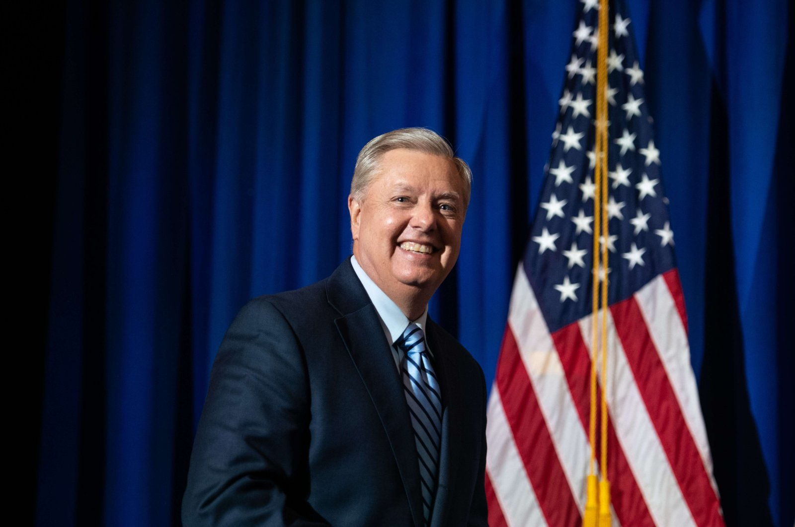 U.S. Sen. Lindsey Graham walks on stage after a win during his election night party, Columbia, South Carolina, Nov. 3, 2020. (AFP Photo)